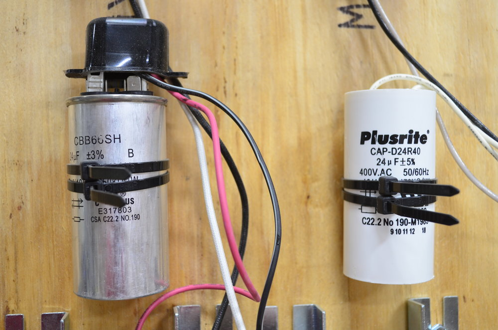 Left - Wet-type 24 mF capacitor || Right - Dry-type 24 mF capacitor