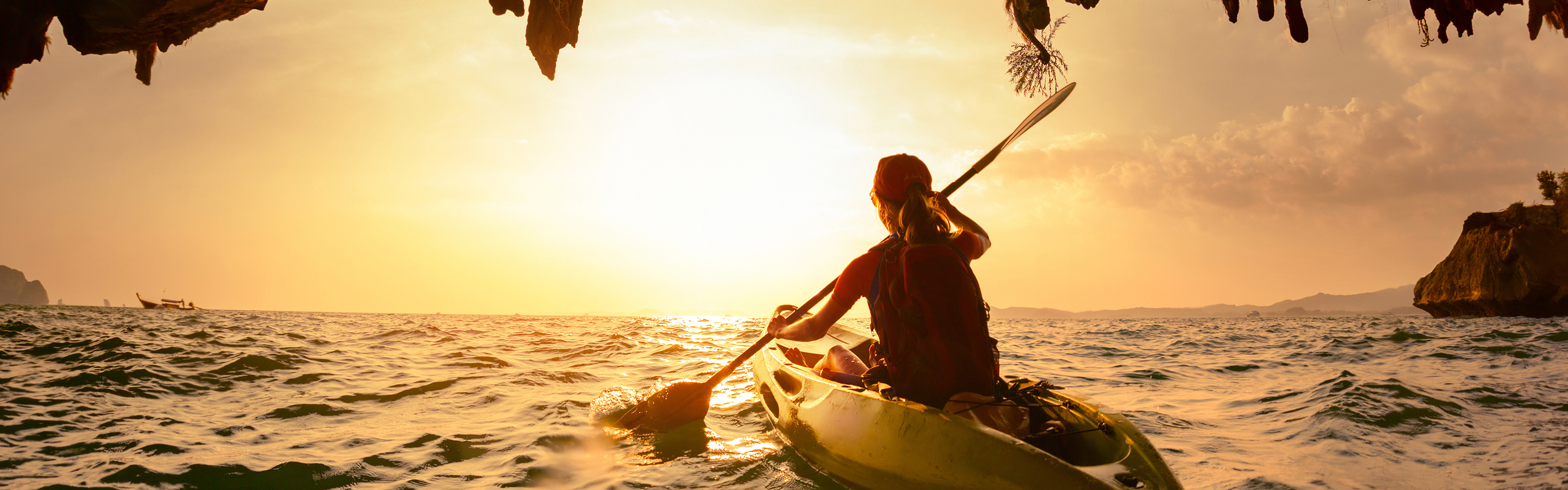Woman-paddling-towards-light.png