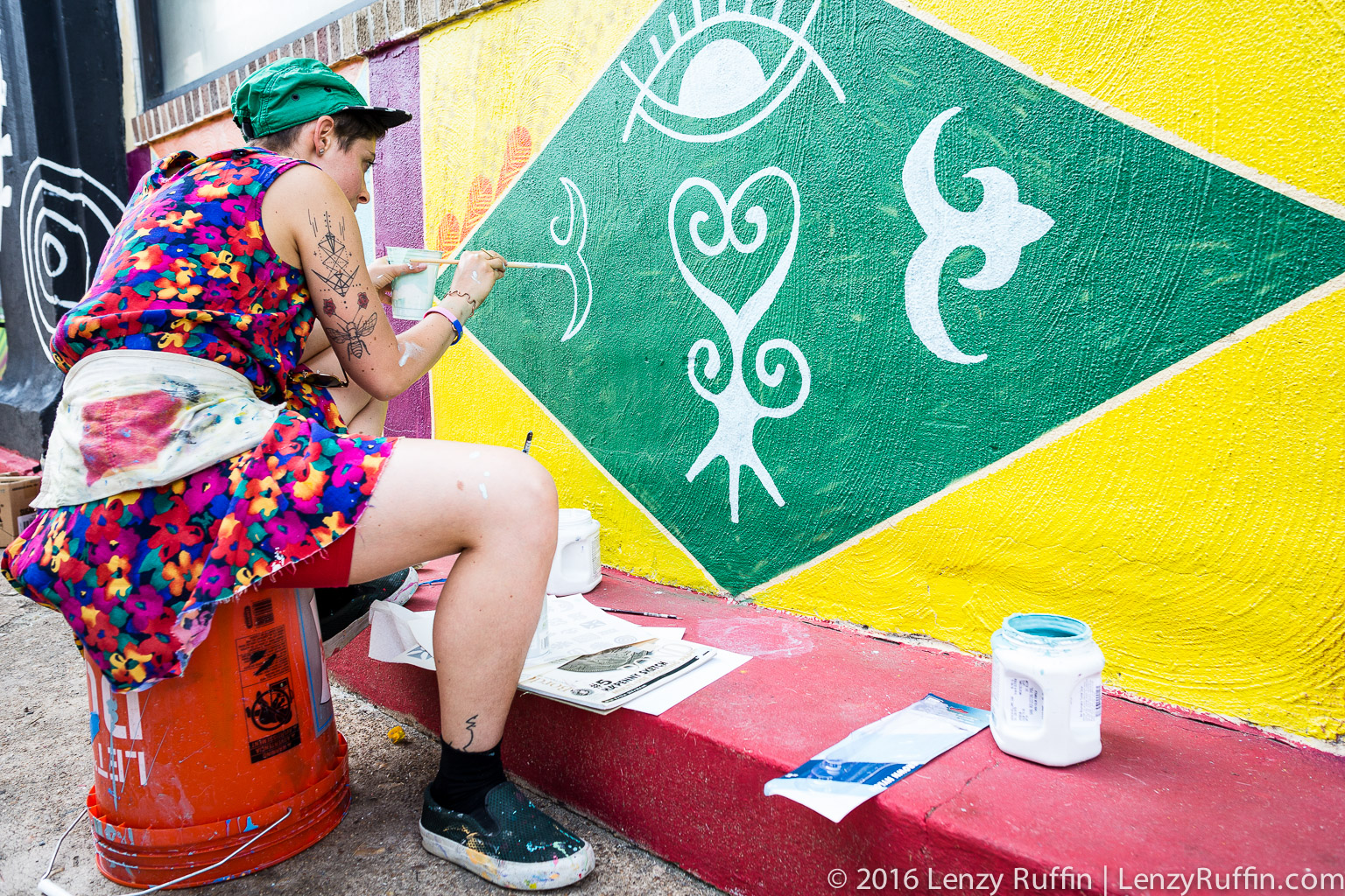 Rose Jaffe (@rose_inks on IG) beautifying the wall in front of Hands On Drums DC.