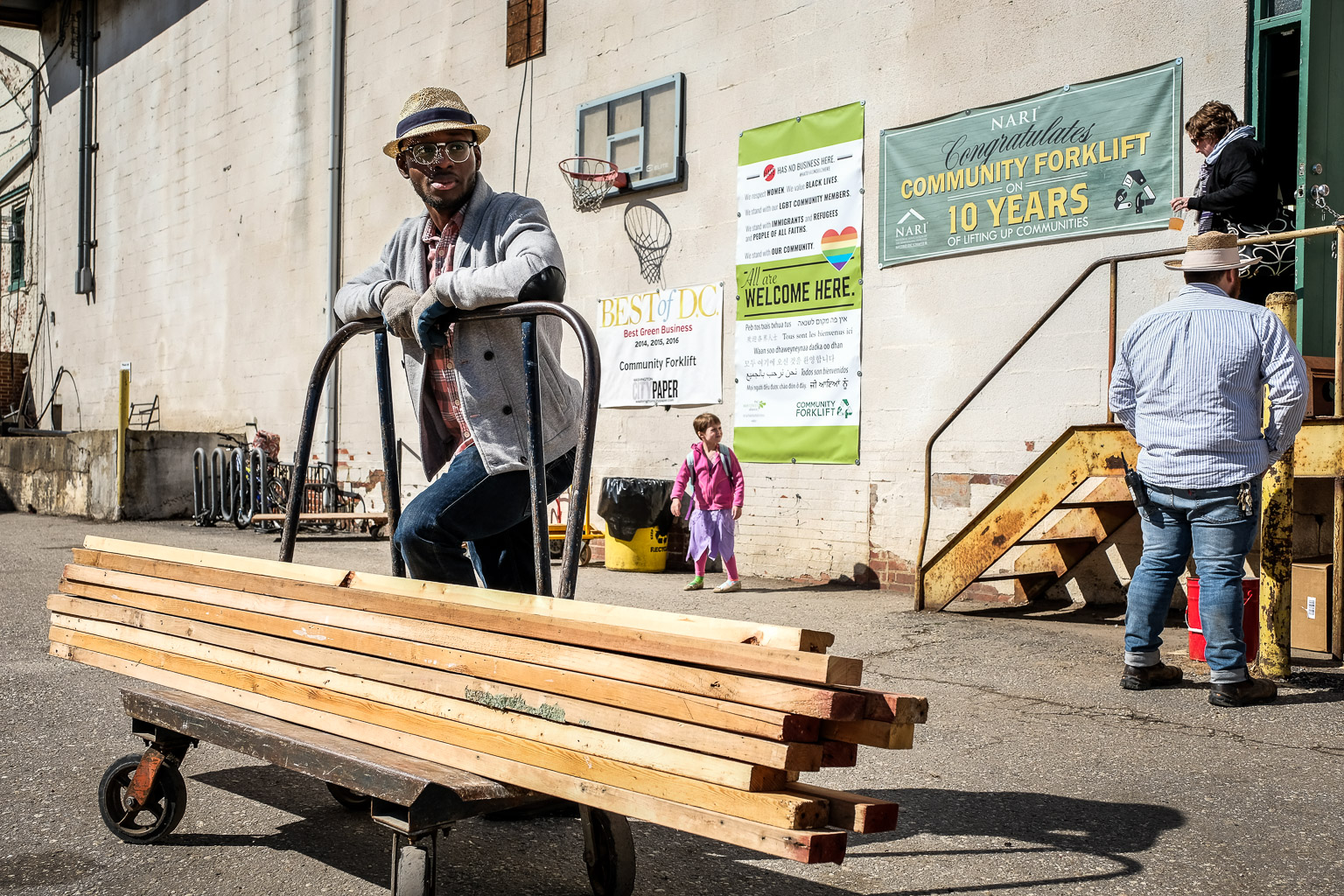 The cart is just a prop. This guy did nothing all day but strike GQ poses using whatever was available. Just kidding! I do love this shot, though. There are so many elements in this frame that make it a perfect storytelling image for the events of the day, as well as for what goes on at Community Forklift on a daily basis. I couldn't stage a scene like this to save my life, but I can definitely see it and shoot it.
