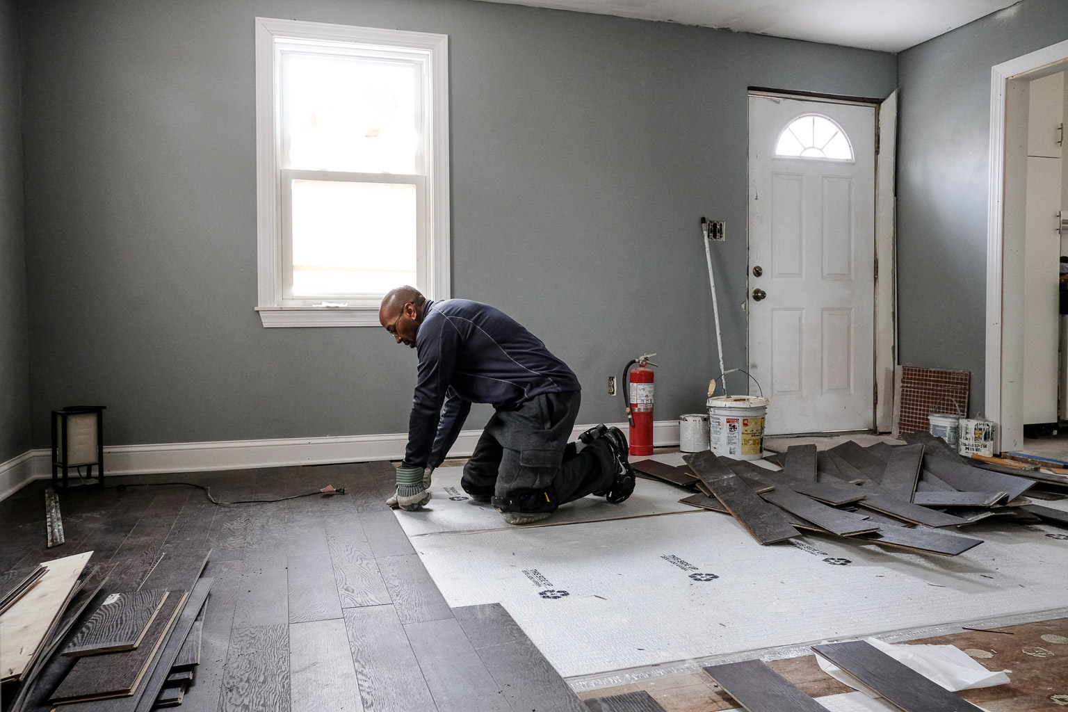 This is me uninstalling the hardwood floor after I fired the contractor I started the project with. That's a long story for another blog post. I had to remove the floor because they did such a poor job of installing it. This was the least of their shabby work that had to be redone.