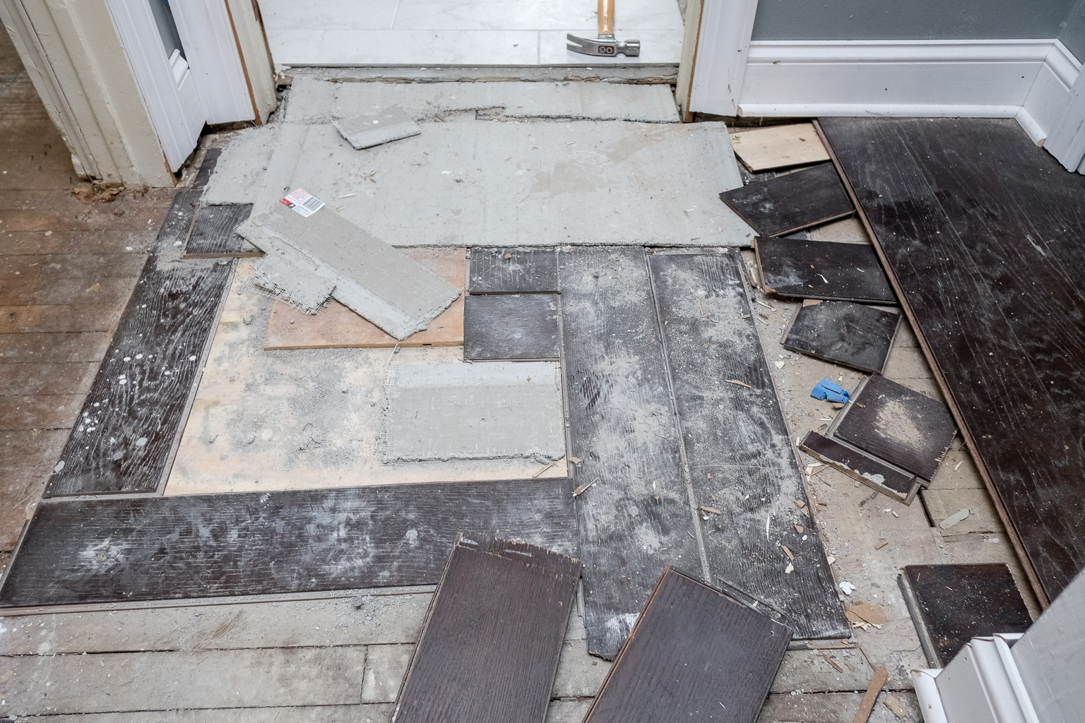 Rather than install a proper underlayment, thievery and incompetence led to the initial contractor using wall board and pieces of the new hardwood as an underlayment. There was such a pronounced change in elevation in this part of the floor, it felt like you walked onto a pitcher's mound.