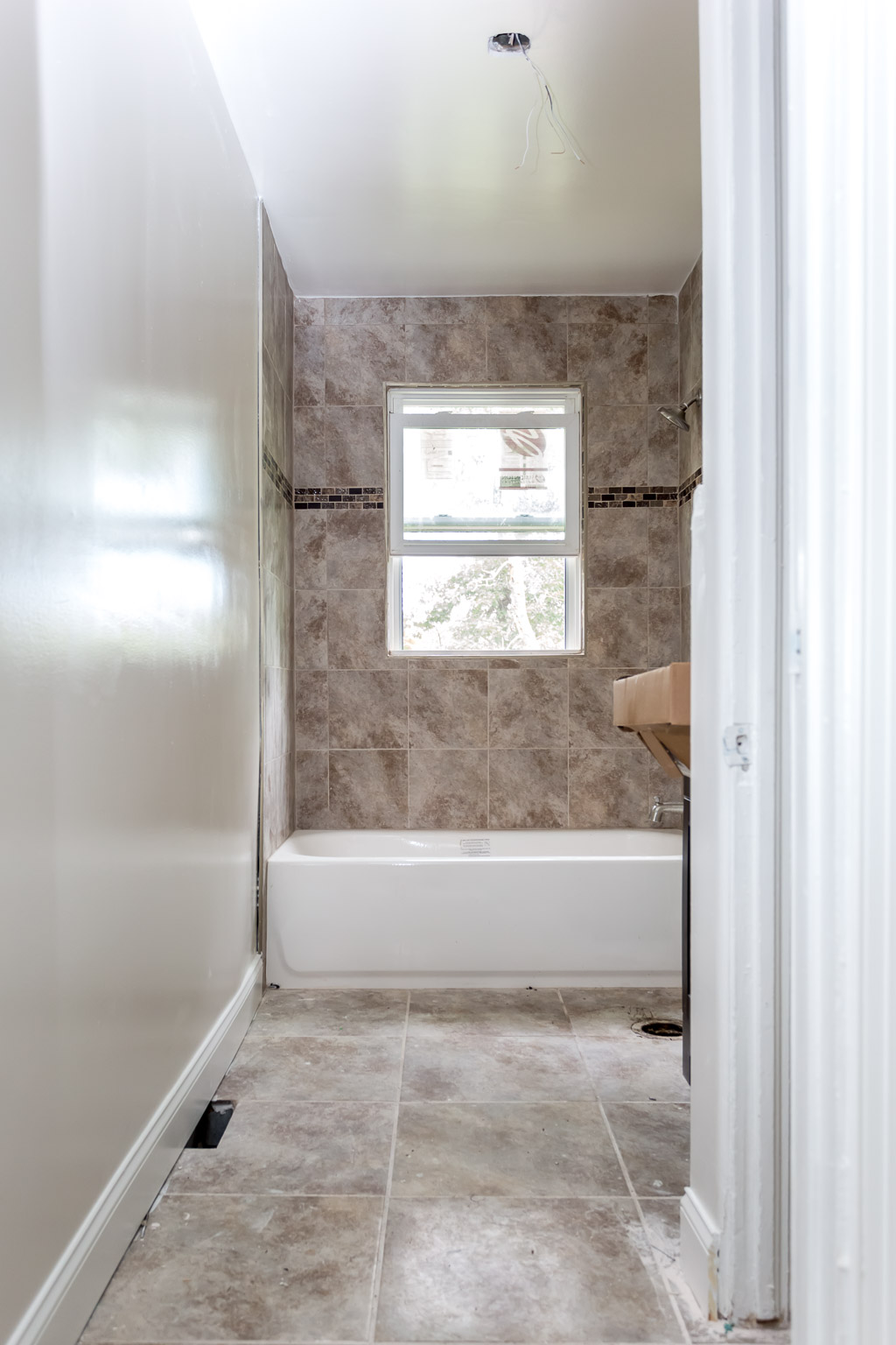This is the bathroom now, after reframing it, re-tiling it, and replacing the tub.