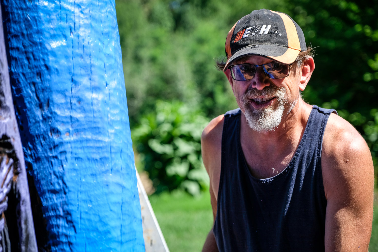 Remember that Achilles I mentioned? Turns out our man Glenn is a master woodworker, but he's also as colorblind as they come. Here he is as proud as can be, painting blue carrots! Somebody at the Arboretum is gonna get canned over this.