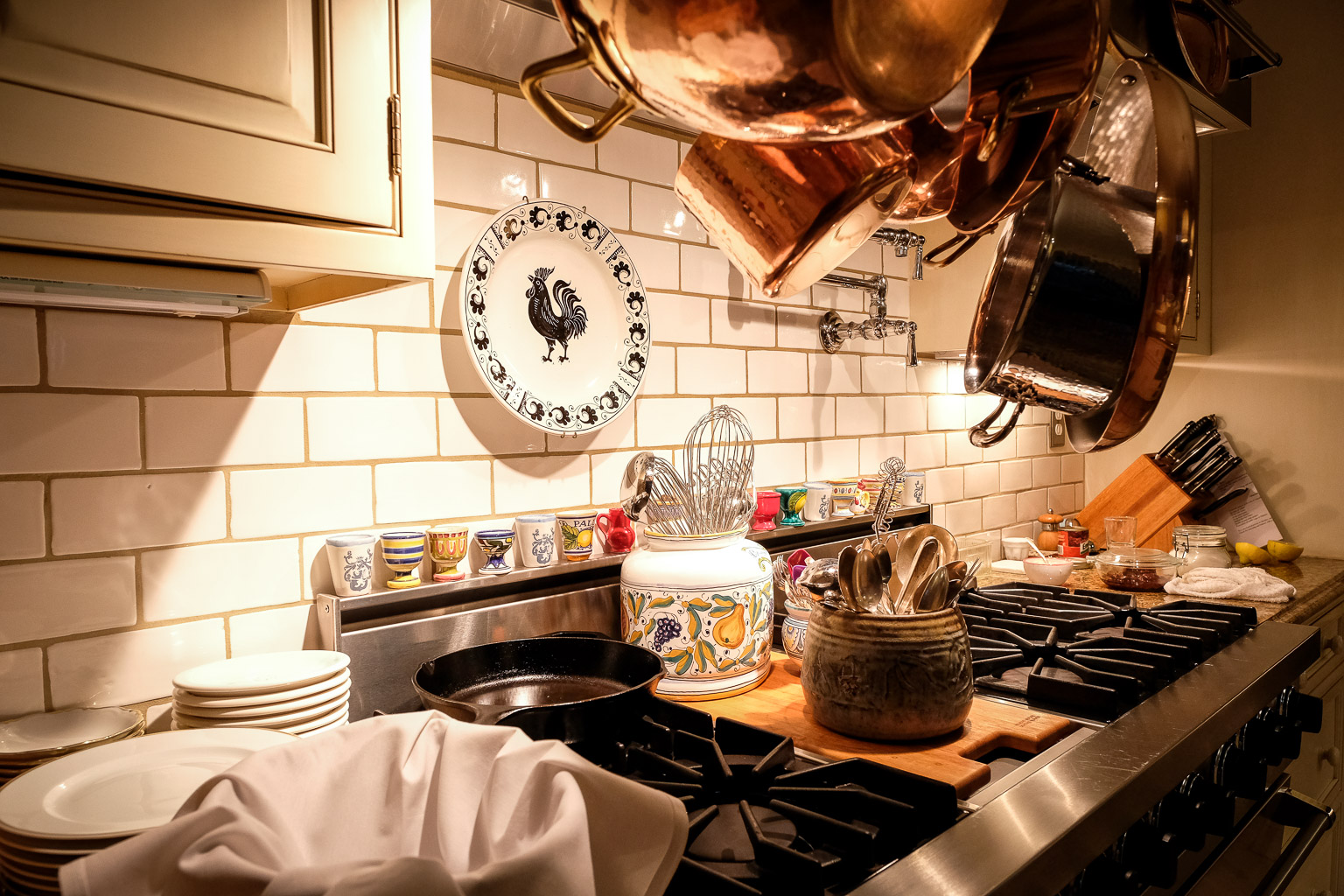 This is not a decorative kitchen. Everything you see here is well-used and meticulously maintained. Look at the finish on that cast iron skillet! If I posted a picture of my cast iron skillet, I'd lose all four of my subscribers.