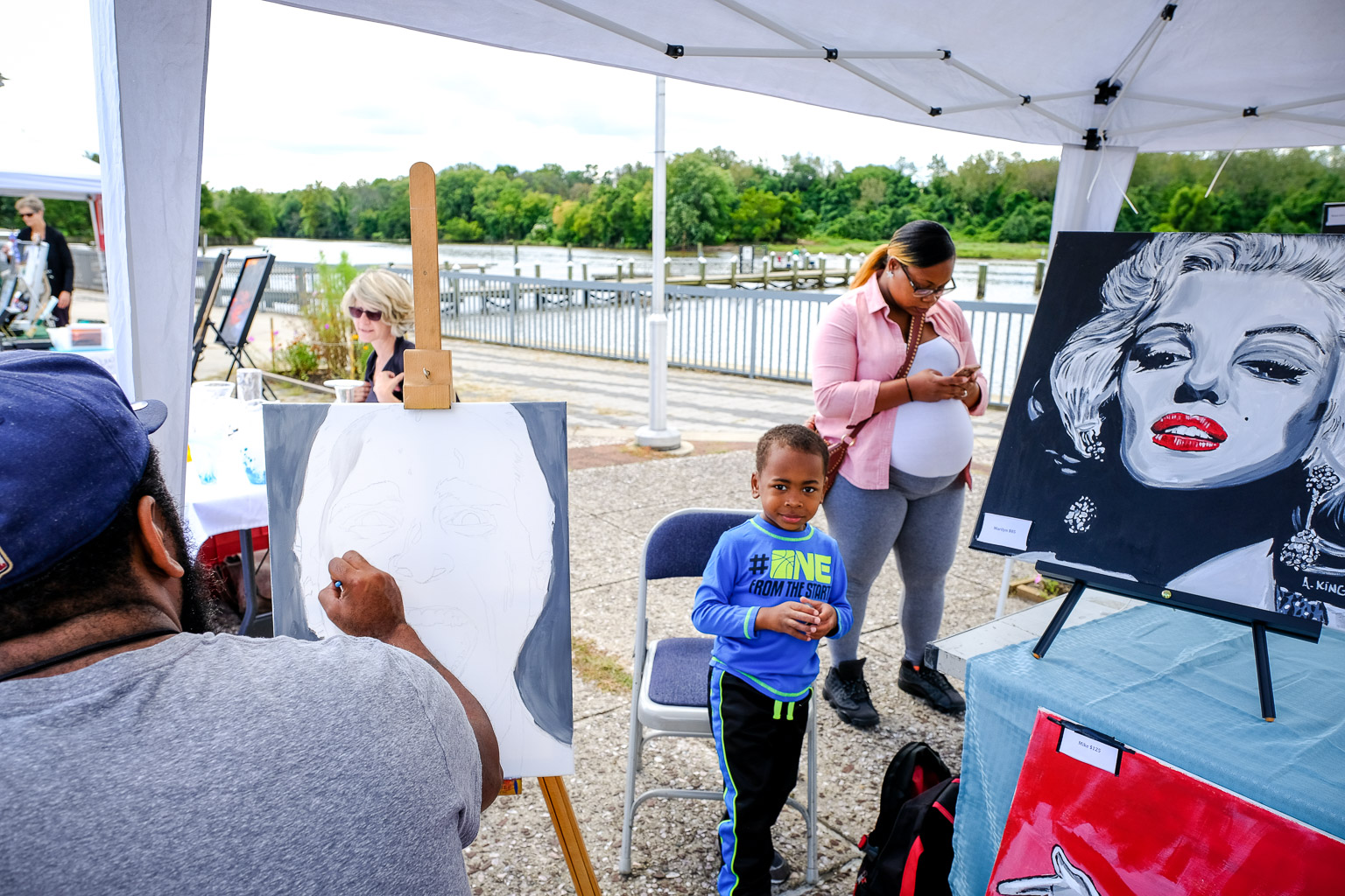 As you can see, art festivals are a family affair for this artist. He had his whole tribe out there with him.