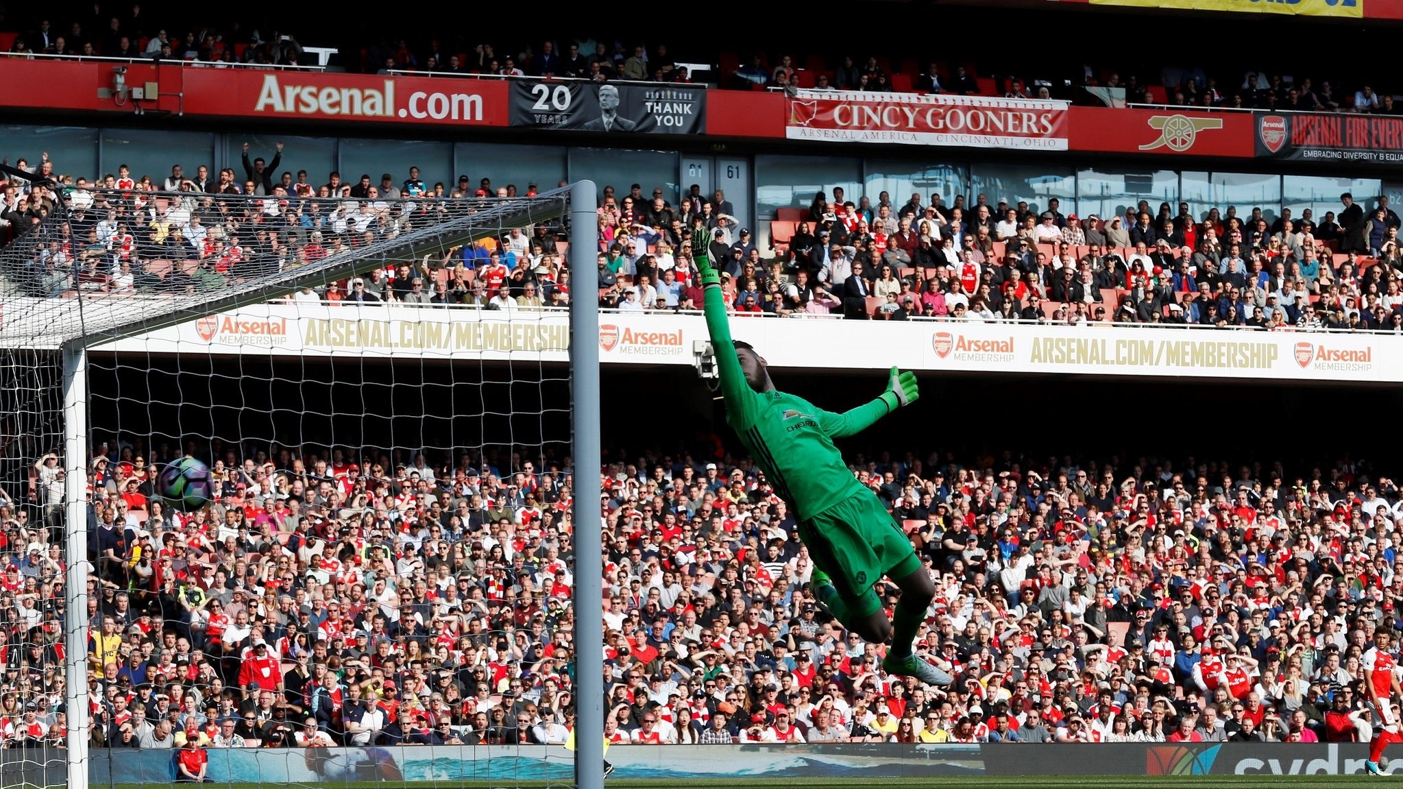 Our banner in the background as Xaha beats de Gea