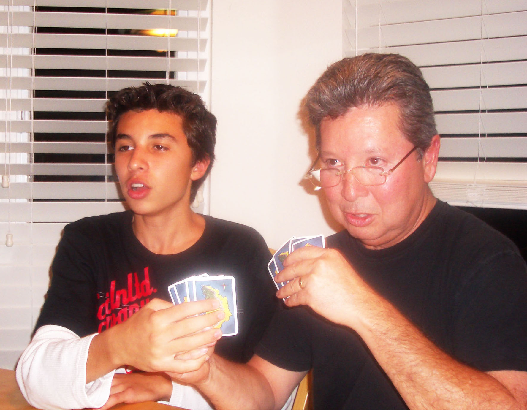 Daniel and dad playing cards cropped.jpg
