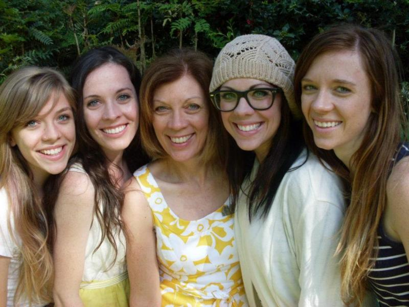 Tami Auda flanked by her four daughters