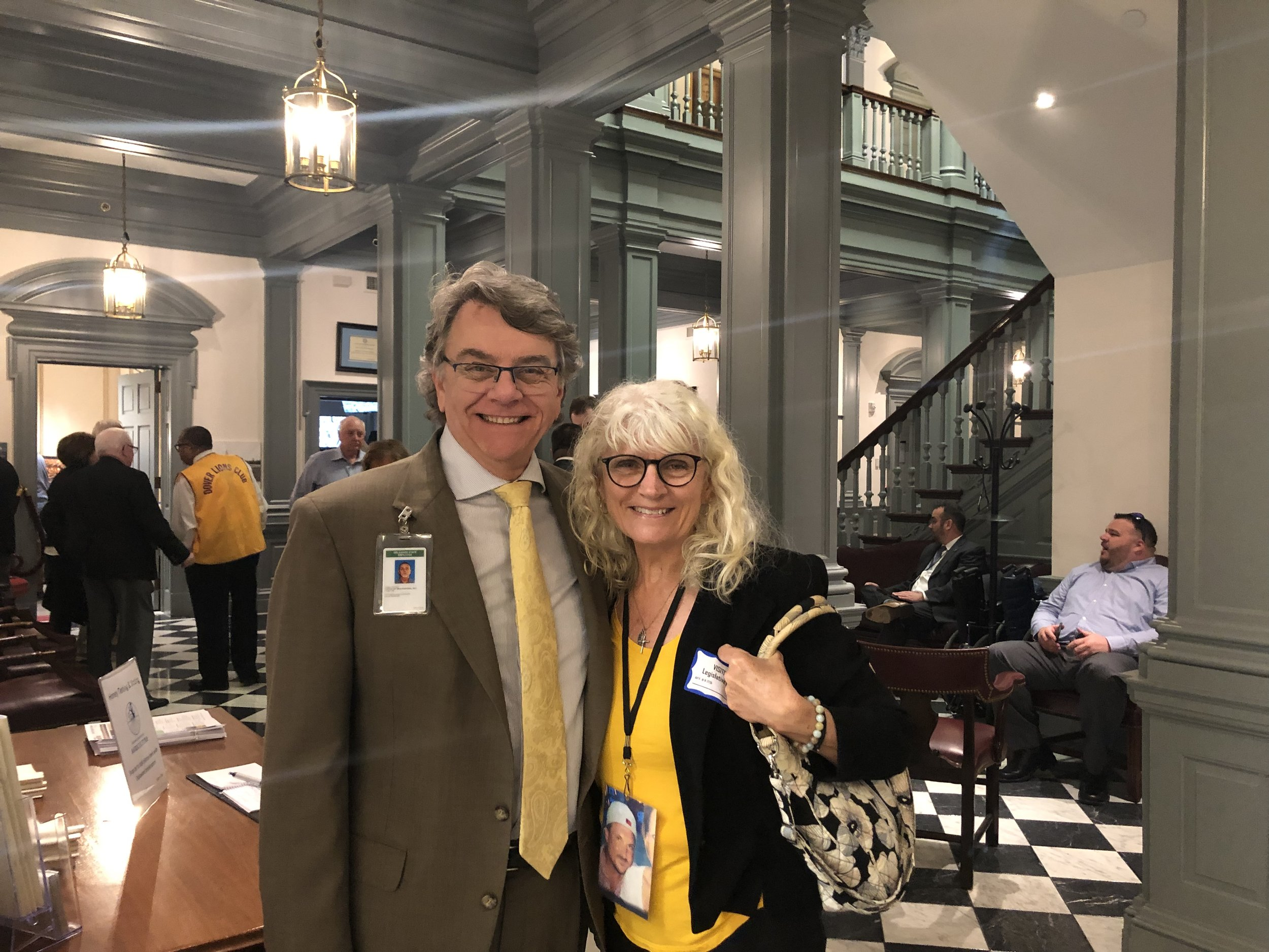 MaryBeth with a photograph of her son around her neck and David Mangler from the State of Delaware on April 9th at Legislative Hall in Dover Delaware