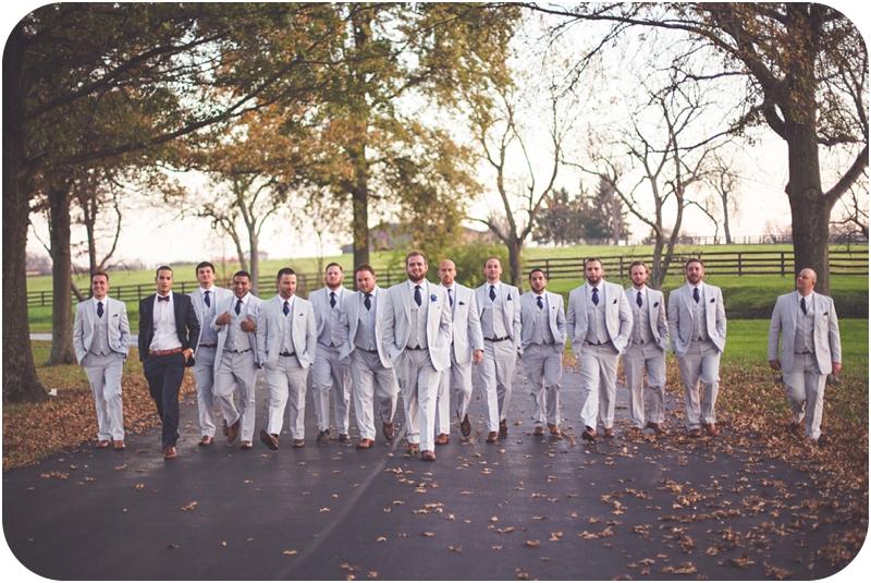 big bridal party of groomsmen, groomsmen walking at fasig tipton wedding