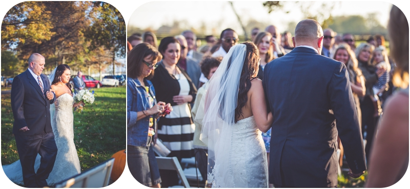 bride walking down the isle with father during sunset wedding ceremony