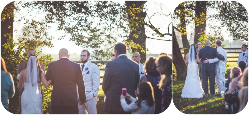 father gives bride away during sunset wedding ceremony lexington KY