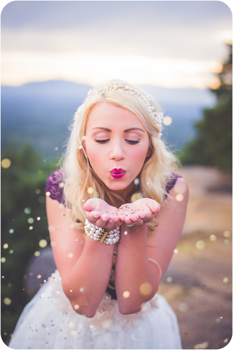 boho bride blowing glitter at camera on mountaintop