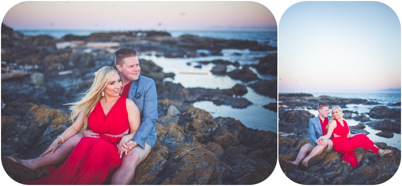 engaged couple sitting on rocks at sunset cattle point victoria bc