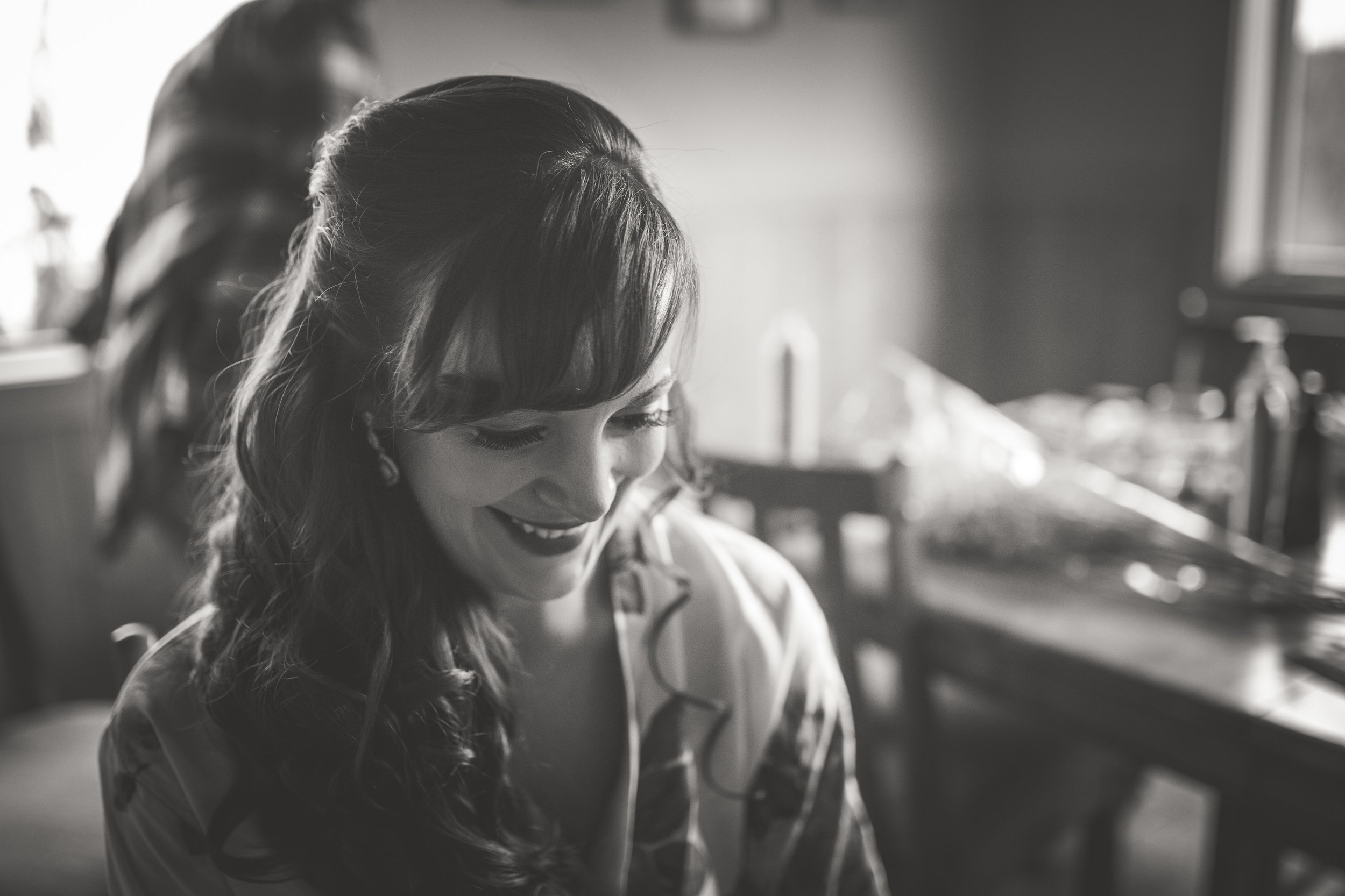 smiling bride gets ready for her vancouver island mountain wedding