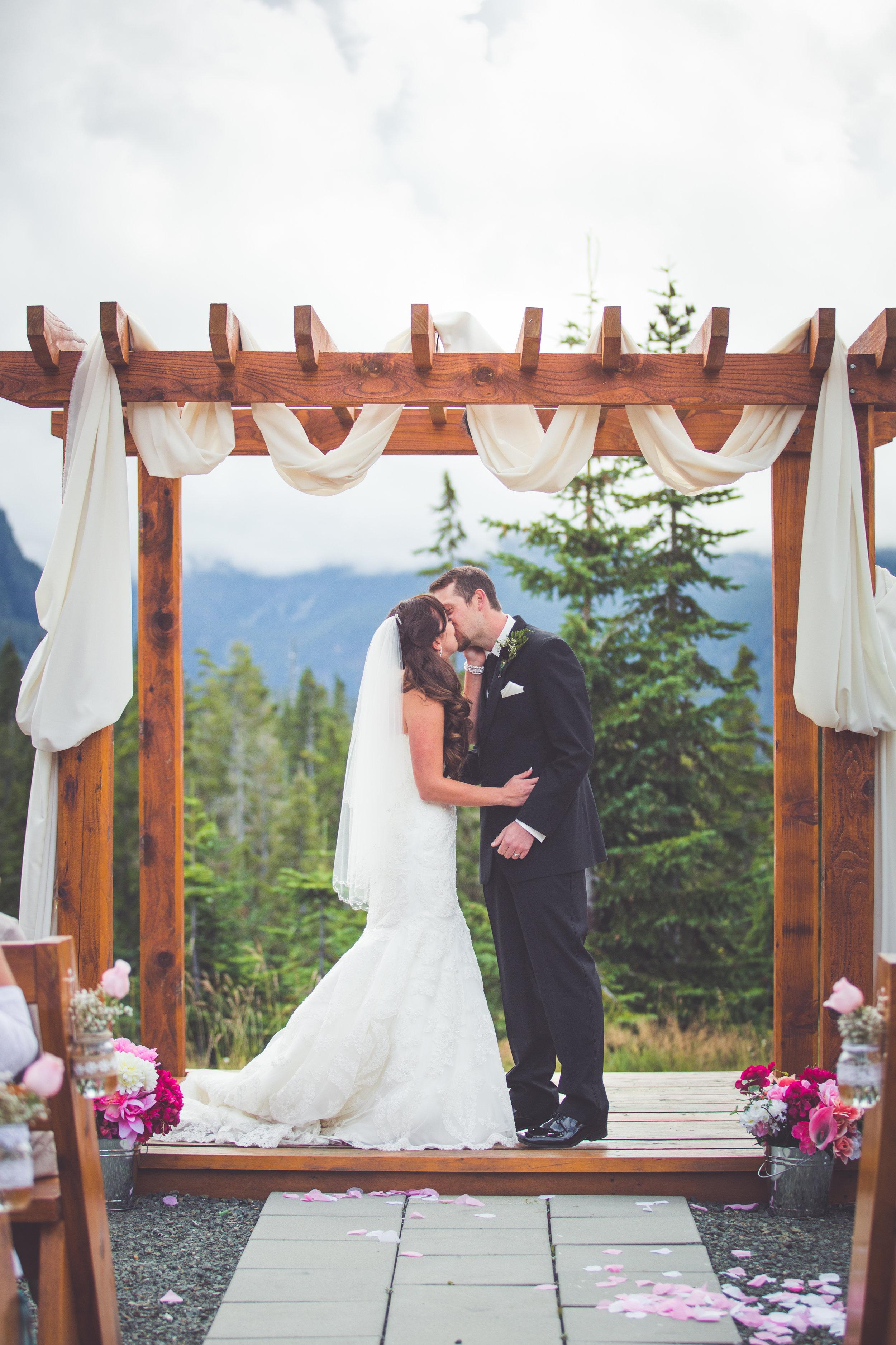 bride and groom kiss at mount washington resort wedding