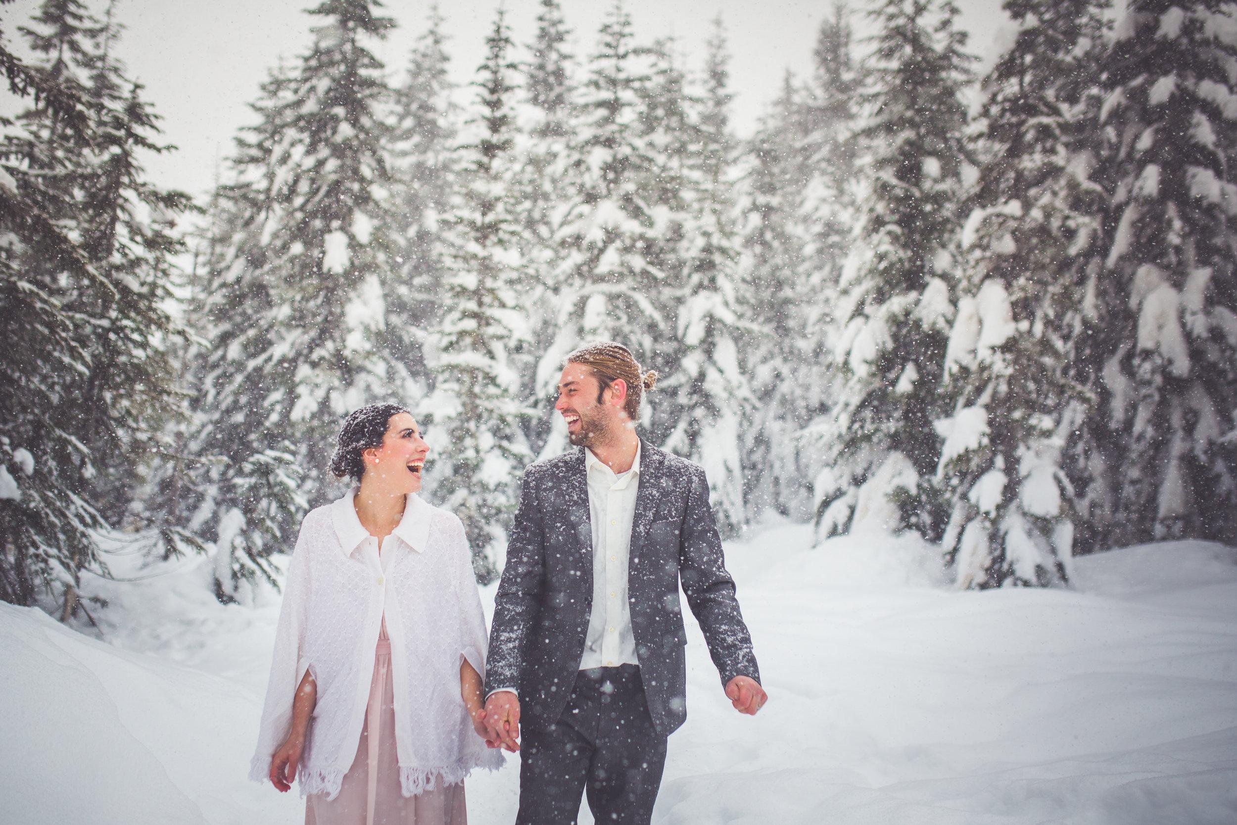 bride and groom laughing at snowy winter wedding at mount washington resort