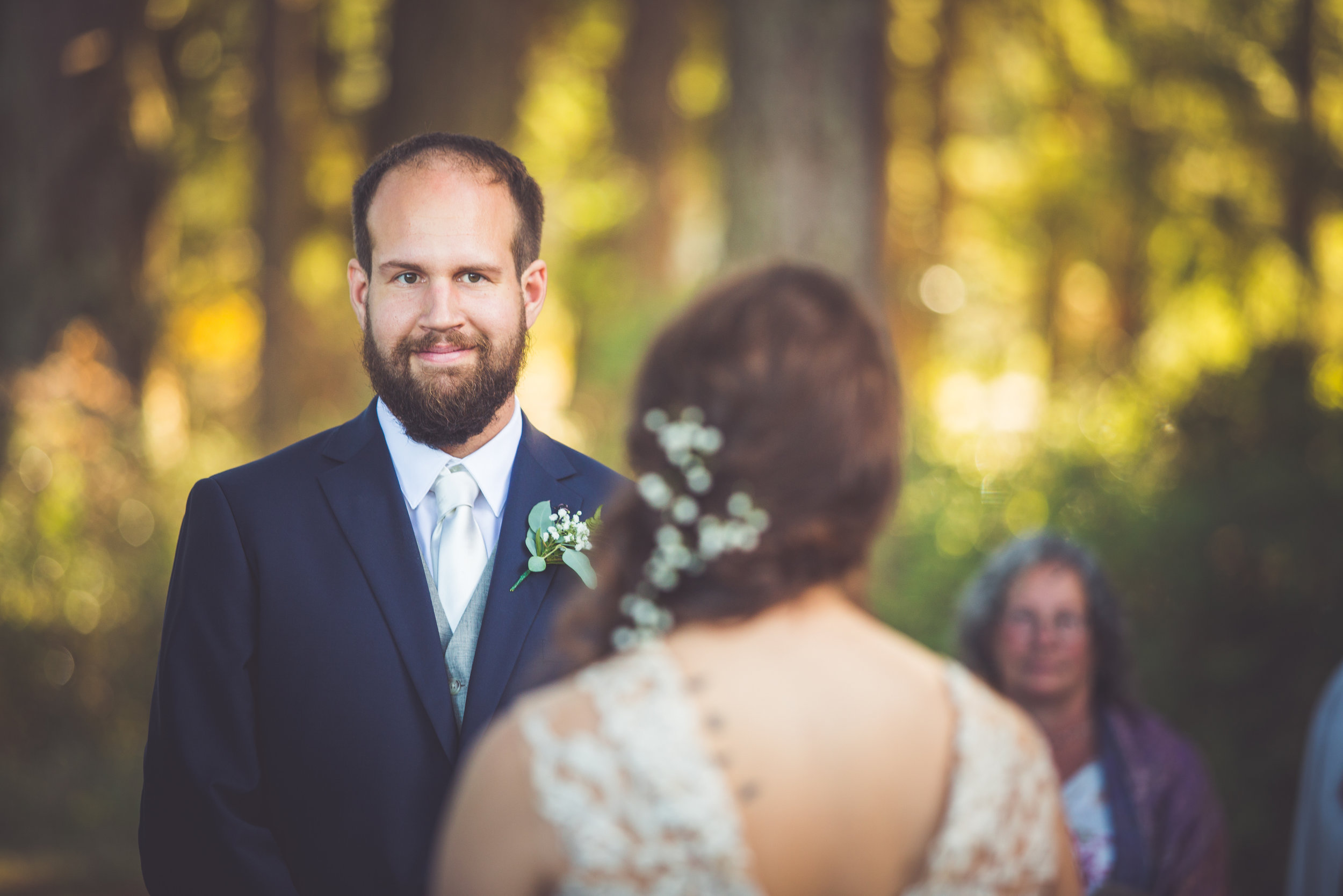 groom looks at bride during parksville bc wedding vows