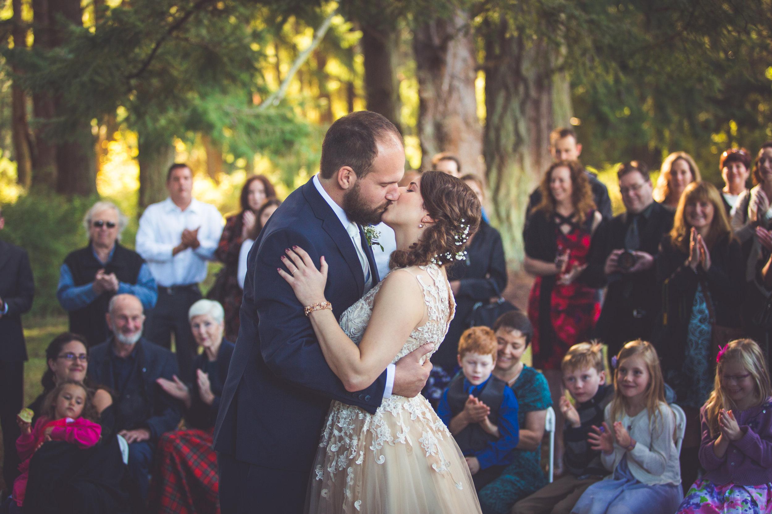 first kiss at rathtrevor beach wedding