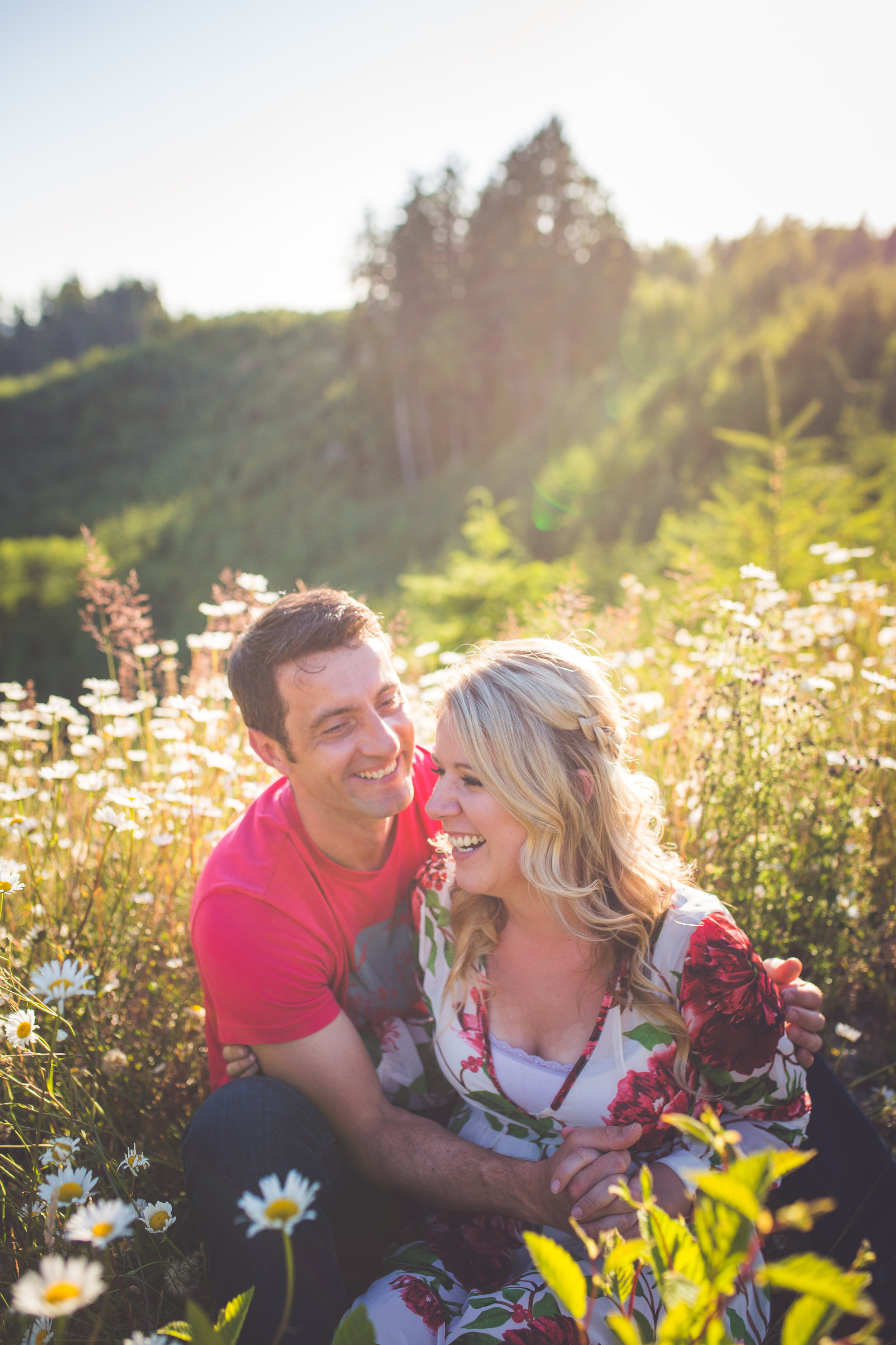 couple laughs during sunset engagement session