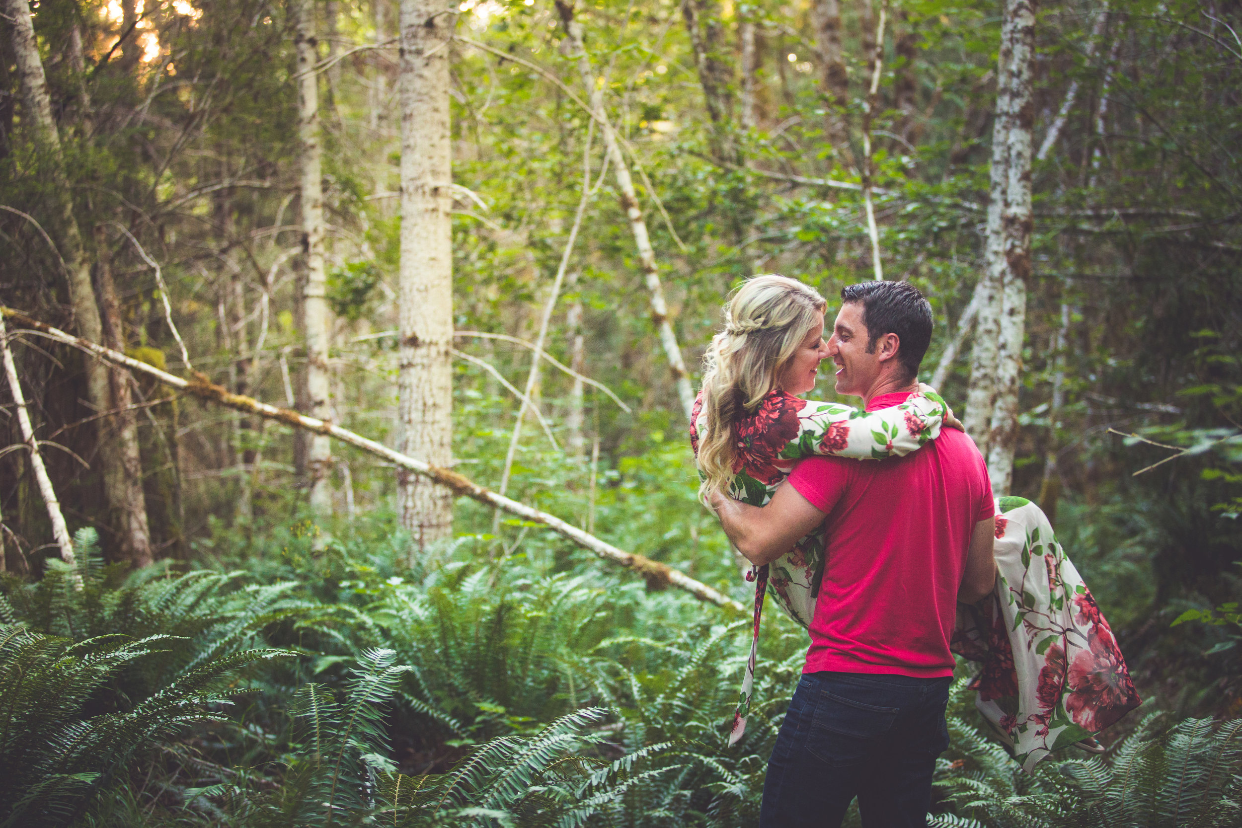 swept off feet during engagement session in Qualicum Beach forest