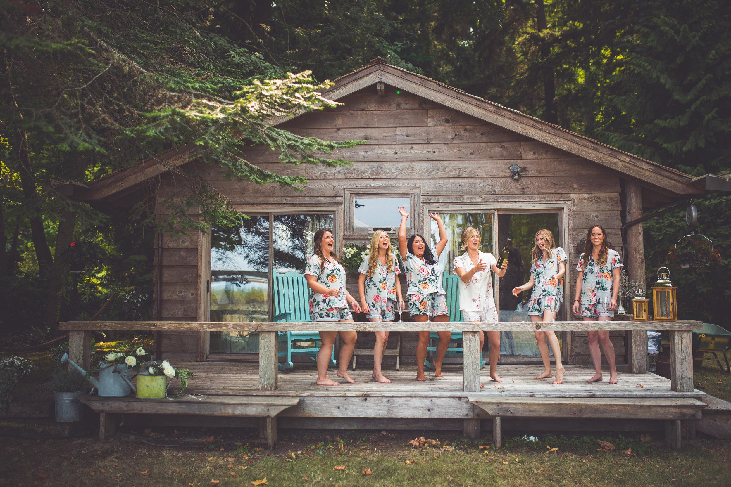 bridesmaids celebrate at cabin