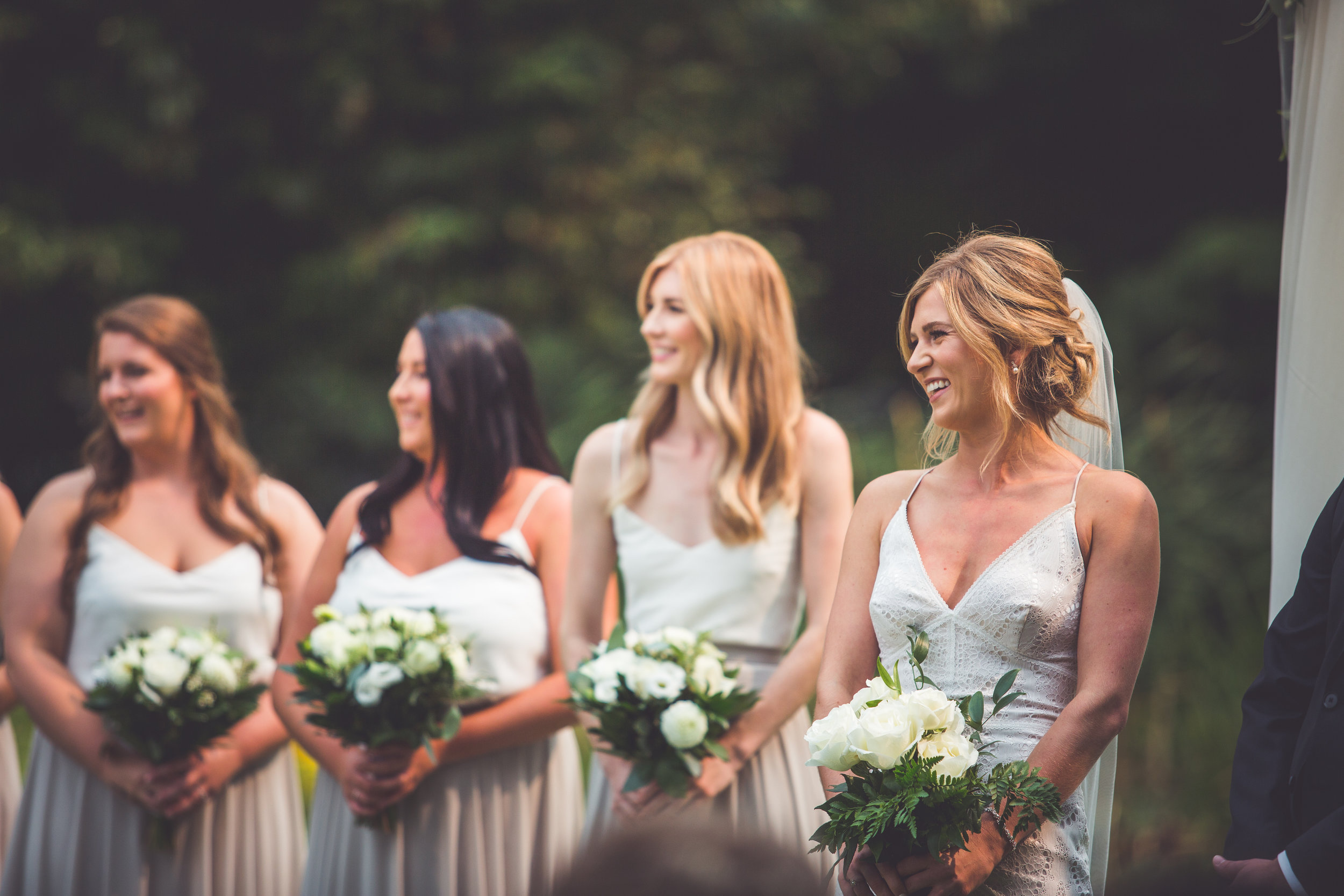 Vancouver Island bride smiles during wedding ceremony
