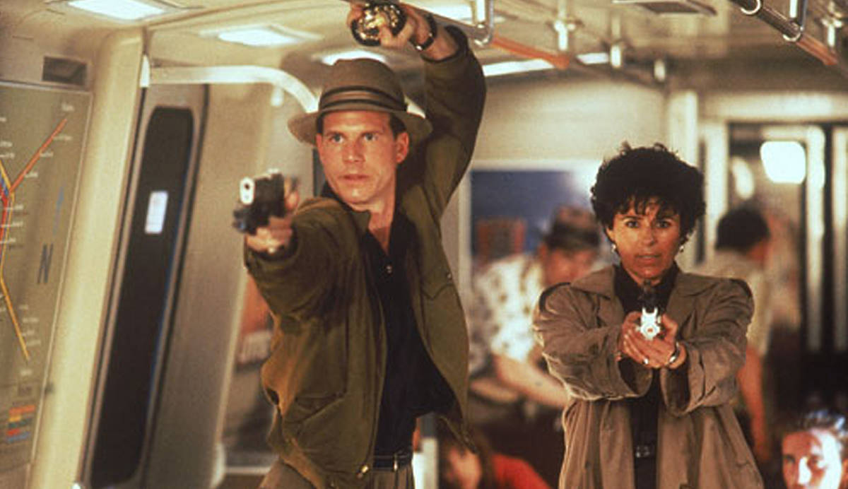 Bill Paxton as Jerry Lambert and Maria Conchita Alonso as Leona Cantrell in Predator 2