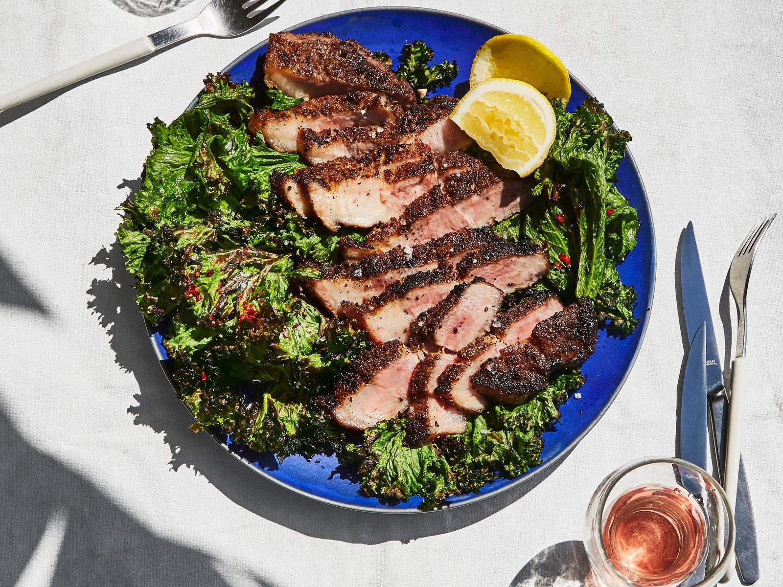 pork-shoulder-steaks-with-grilled-mustard-greens.jpg