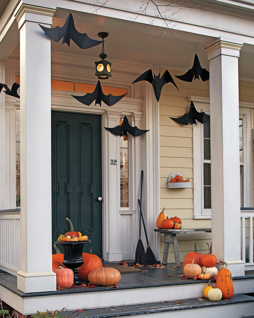 Paper bats hung from the ceiling for Halloween from Martha Stewart   asavvylifestyle.com