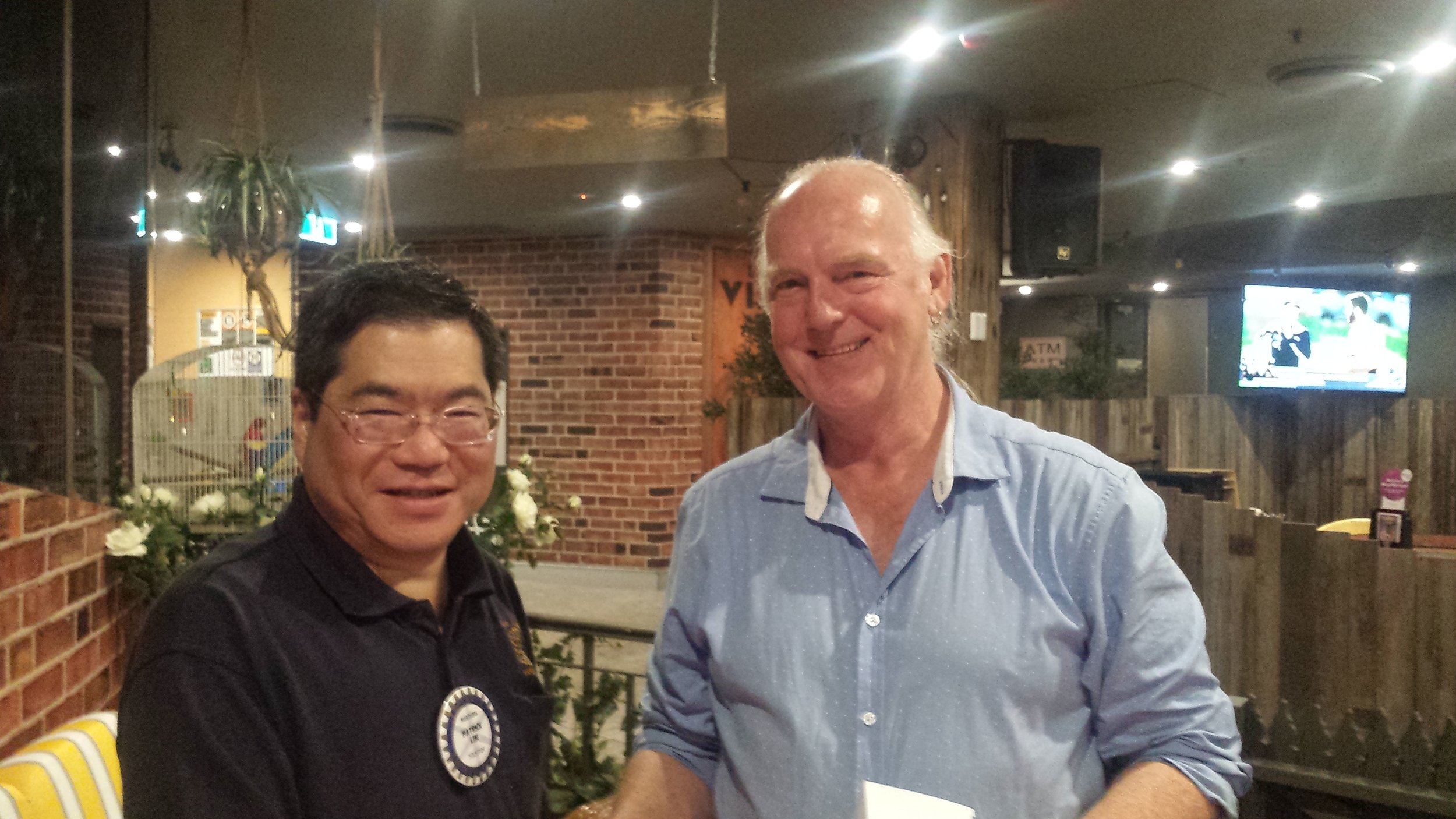 Laurie Matthews with Patrick Lim, President of the Maroubra Rotary Club.