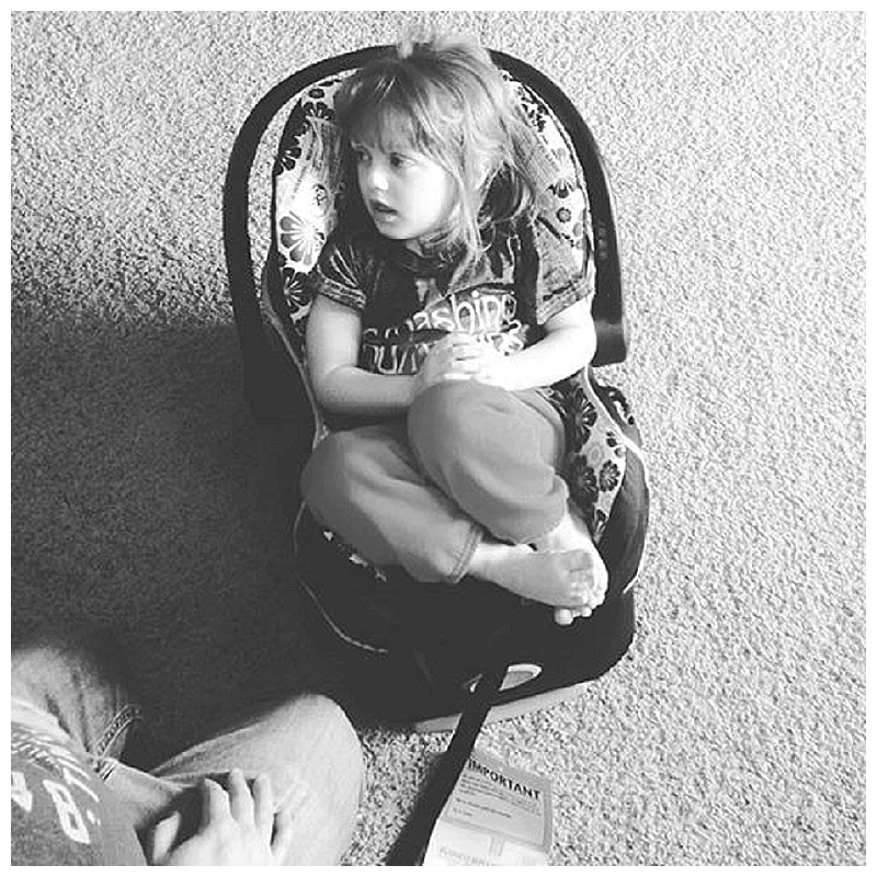 Molly give Baby #3's new seat a test run (She's 5, people. FIVE....and she nearly fits snugly in an infant seat. MY.KID.IS.WEE.