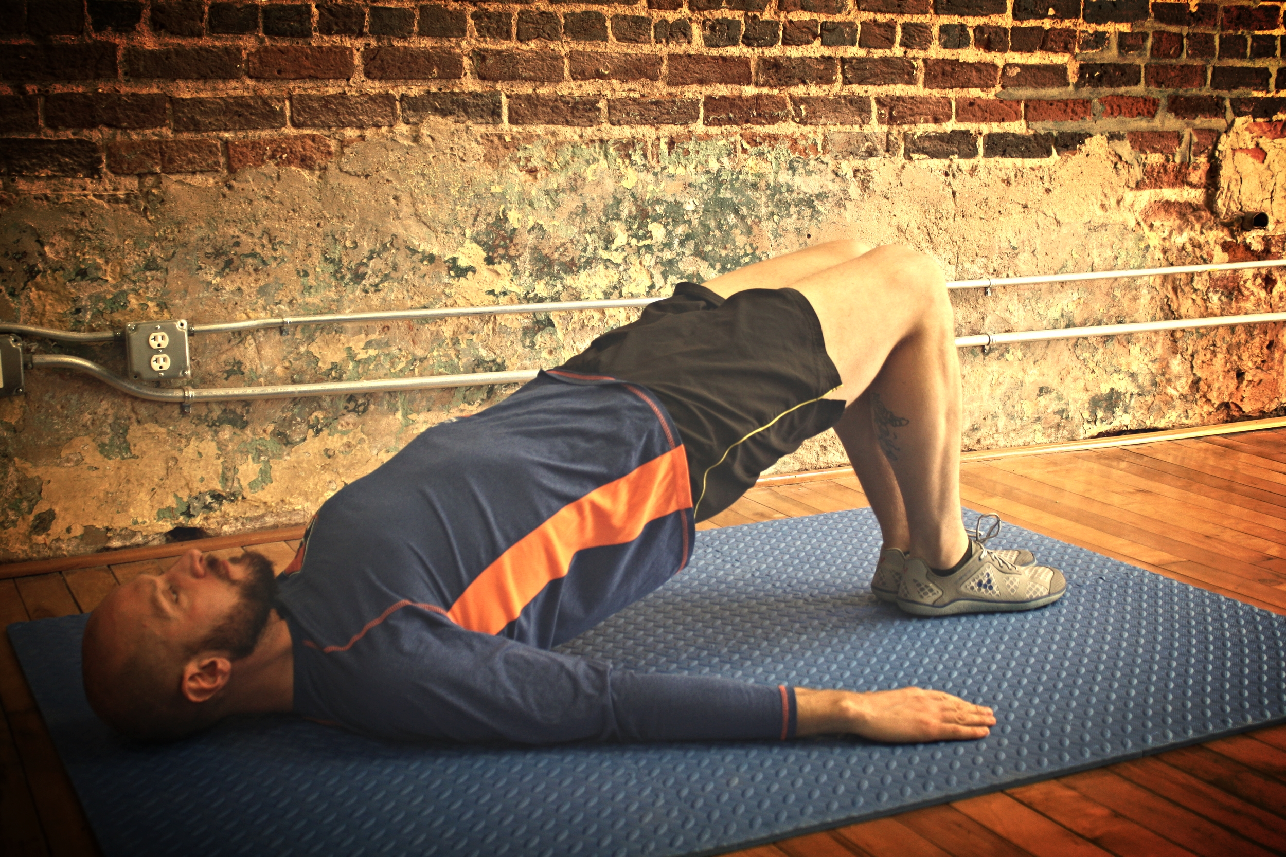 Supine bridging with knees and feet together
