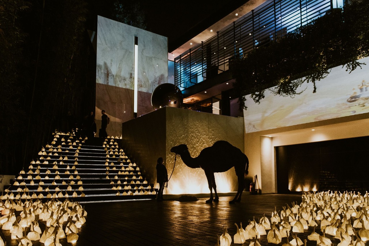 A camel at an elaborate bash for a home seeking $39.995 million. PHOTO: THE SOCIETY GROUP