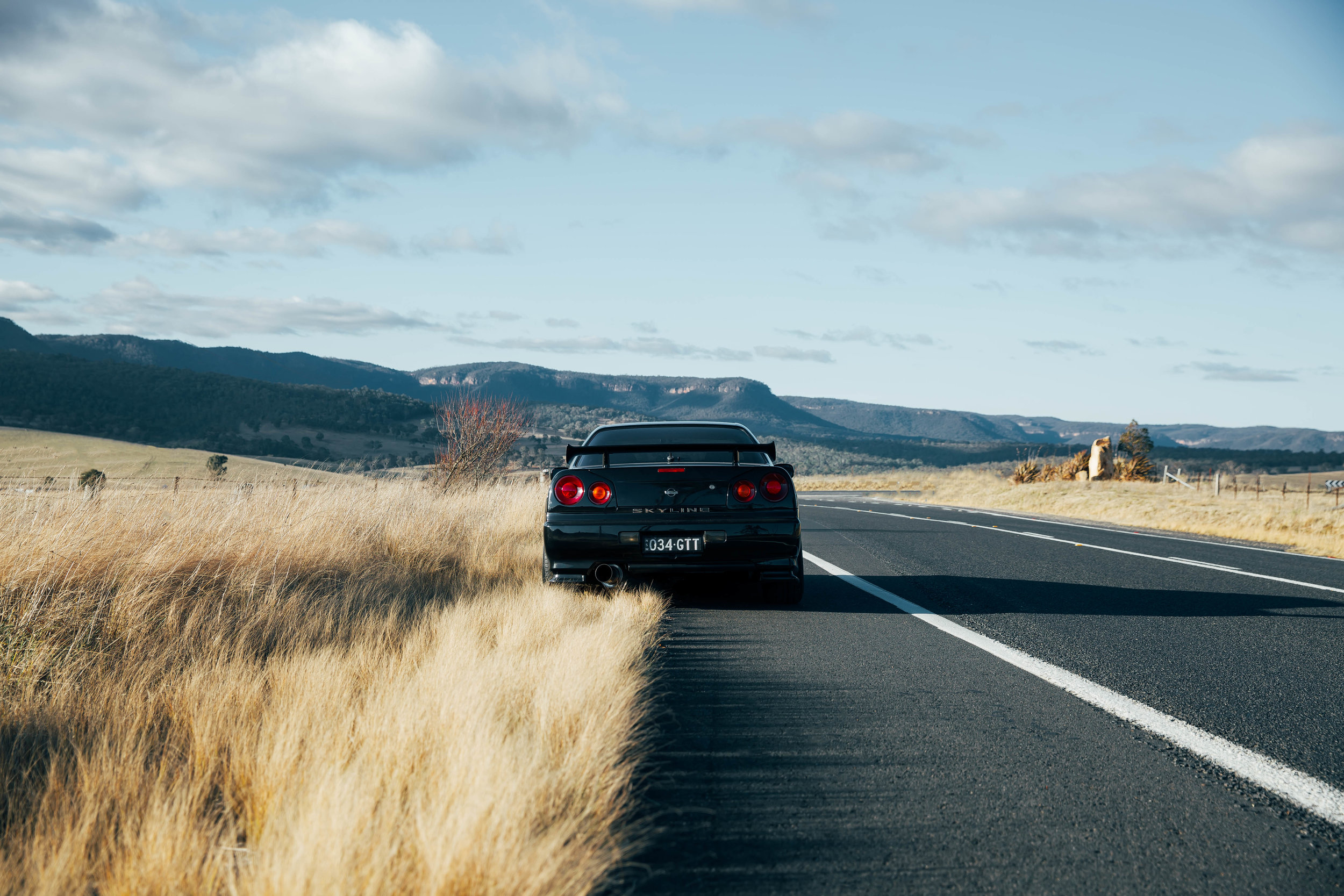 Another shot of my R34 taken at Oberon for my look book. I'm all about the blue and earth tones. Photos like this just make me want to get out and drive!