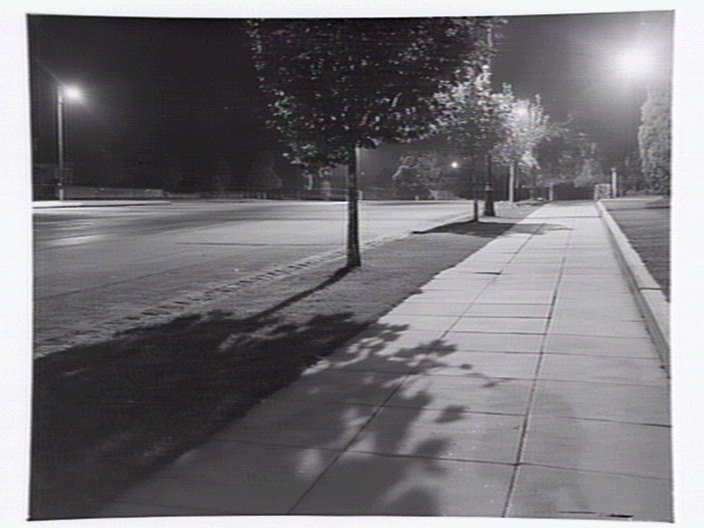 When darkness falls, more and more young people have nowhere to go. Suburban street, Box Hill, at night, Lyle Fowler (1949). Photo courtesy of the  State Library of Victoria .