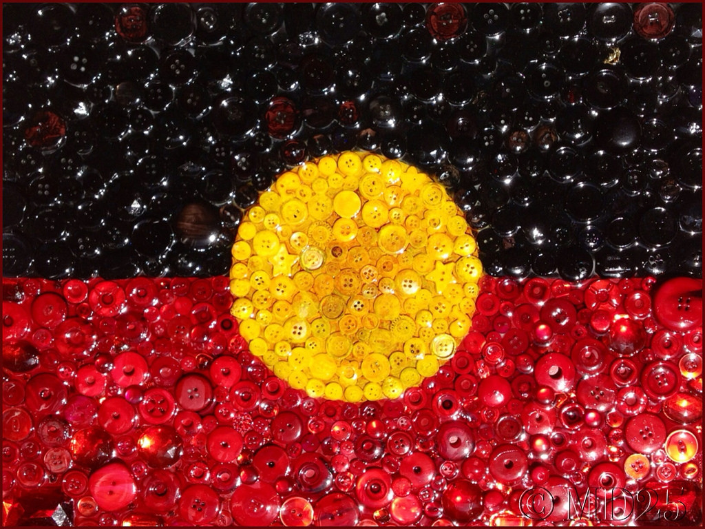 """The patriarchal colonial state has often sought to regulate and control Indigenous women rather than empower them.""  Artistic rendering of the Australian Aboriginal flag by Marty D ."