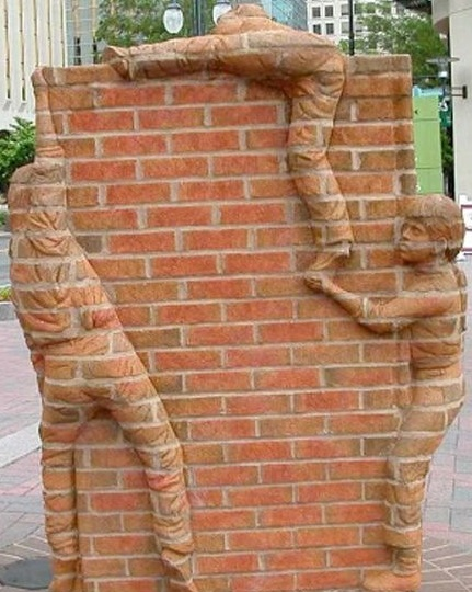 """Conditional welfare creates barriers to recovery for single mothers and their children.  Sculpture by Brad Spencer , """"Life is an Open Book,"""" Charlotte, NC."""