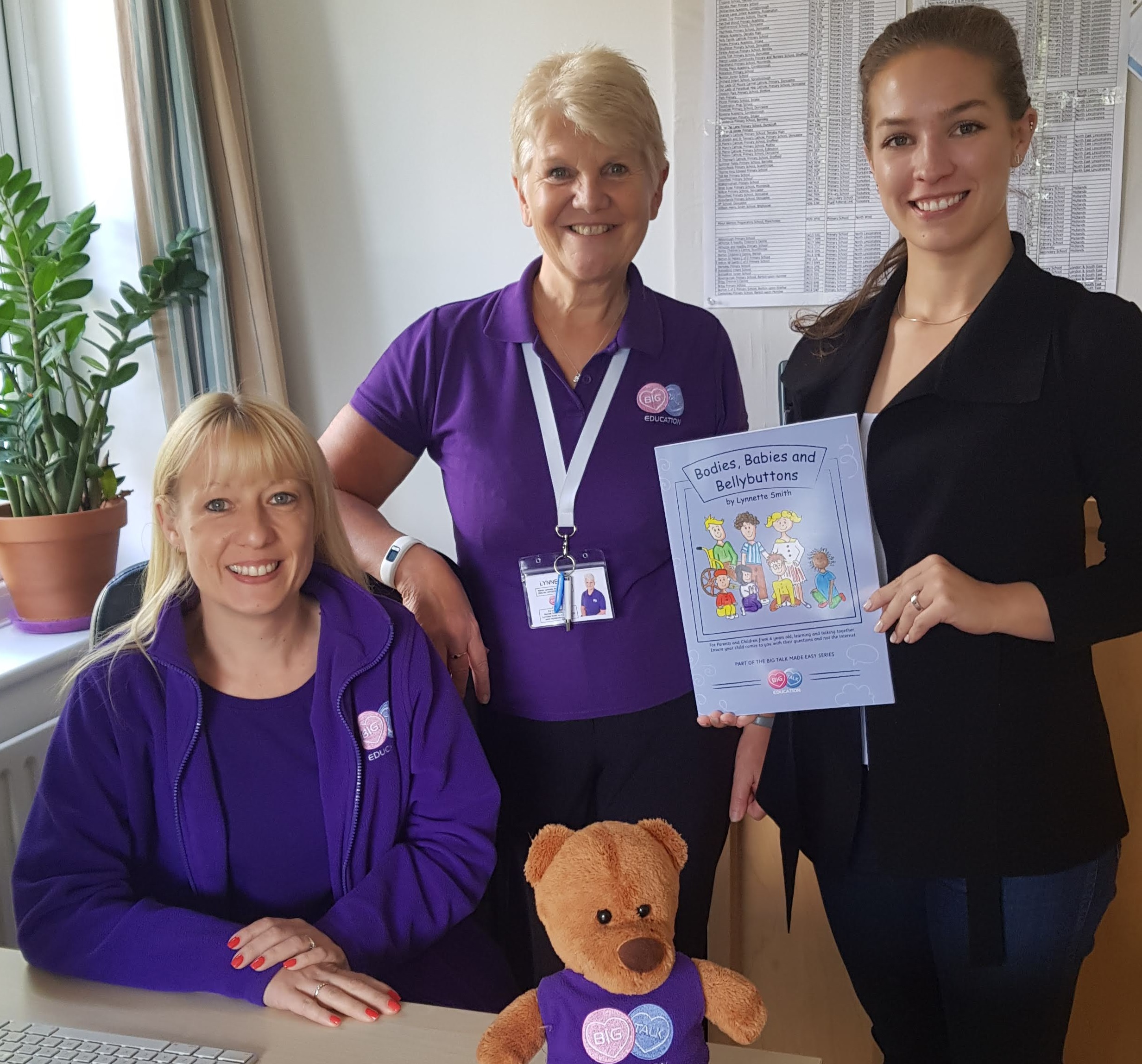 """Learning best practice from overseas: Katrina Marson holds a copy of """"Bodies, Babies and Bellybuttons"""" while meeting with booklet author Lynnette Smith (centre) and Hayley Robinson of BTE. Photo courtesy the author."""