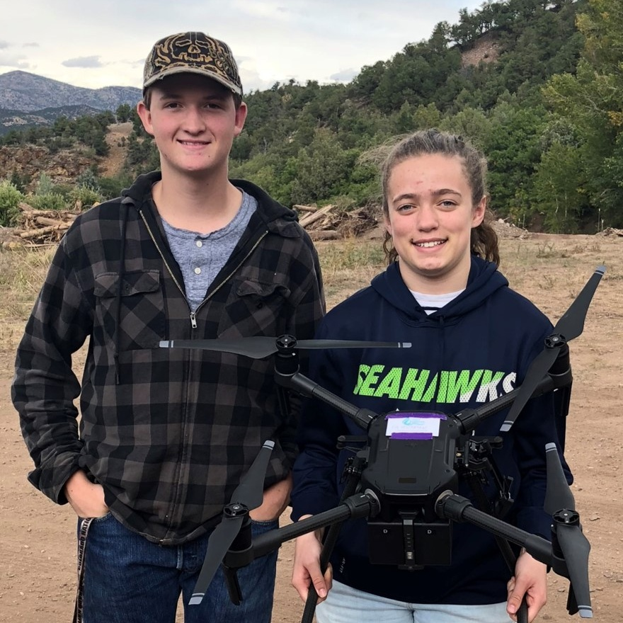 Canon City High School Students Ethan and Asemah learn surveying and drone photogrammetry.