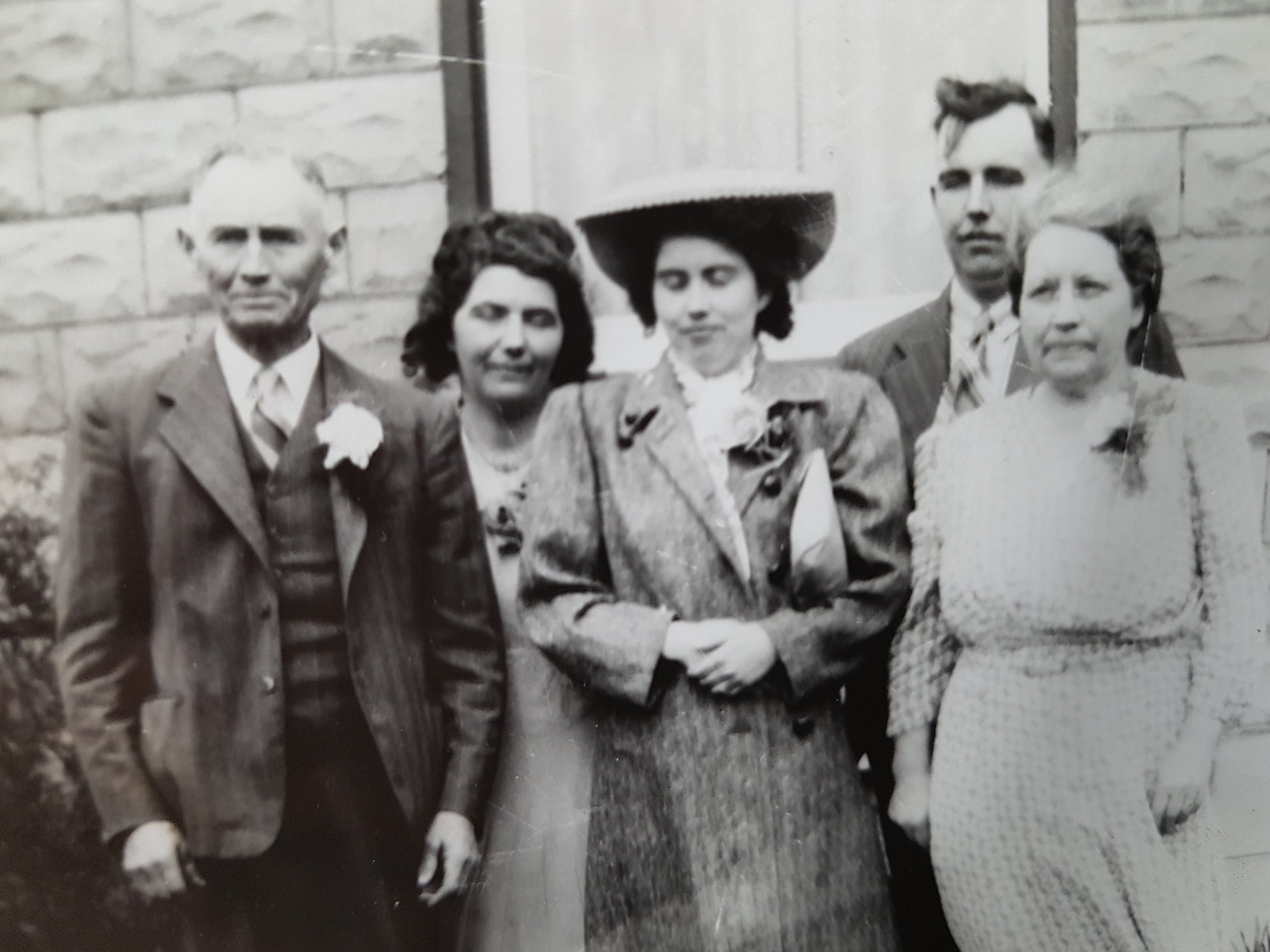 Verna with Parents and siblings.jpg