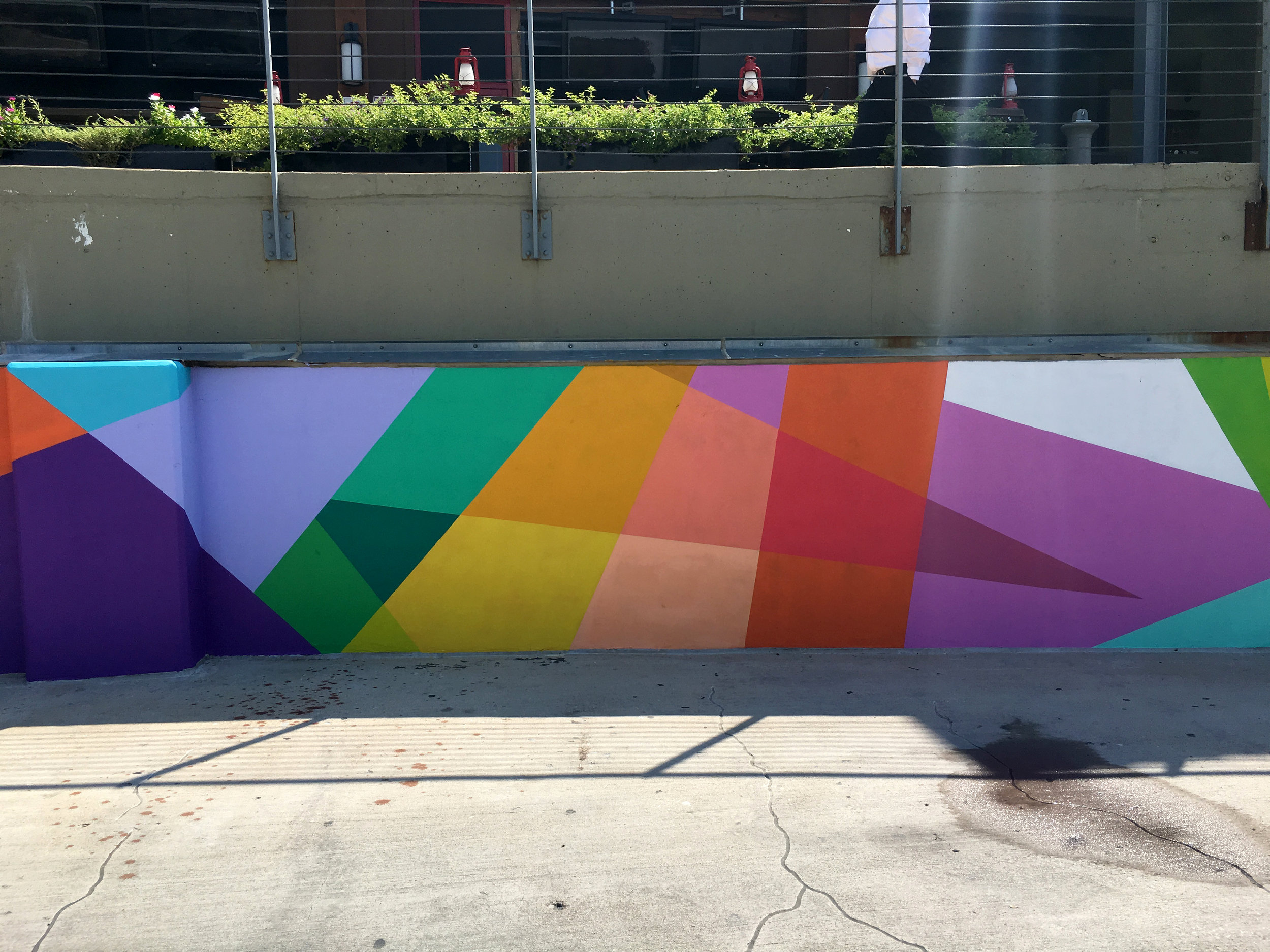 Kennimer's murals are a seemingly random placement of geometry, but have actually been carefully crafted to create a rule for the eye and then break it before a pattern is established.