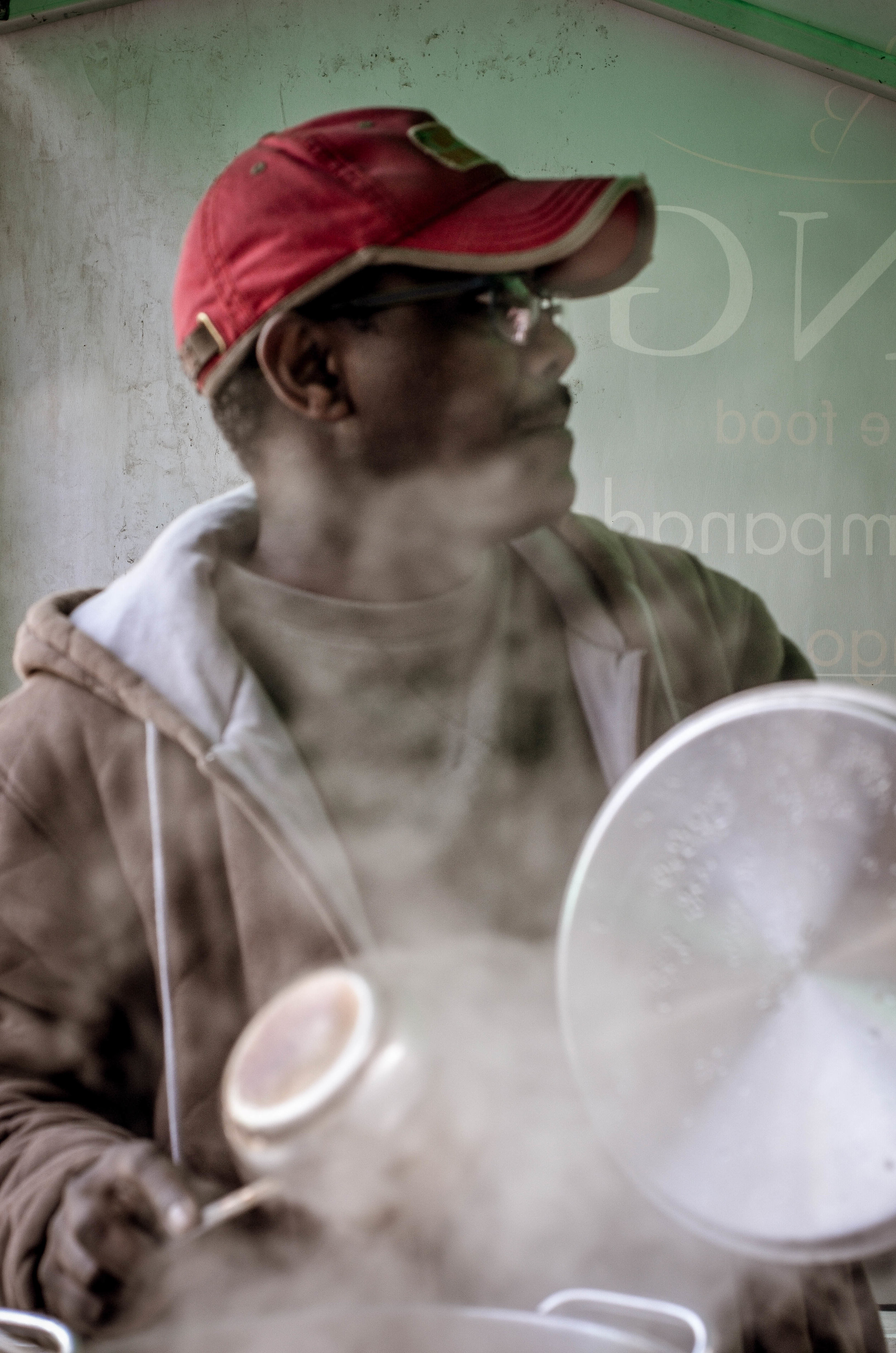 Anwar from Sudan brewing up some chai at the markets.