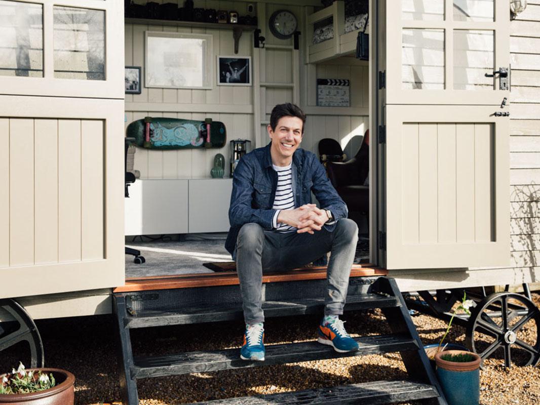 Dan in his shepherds hut home office