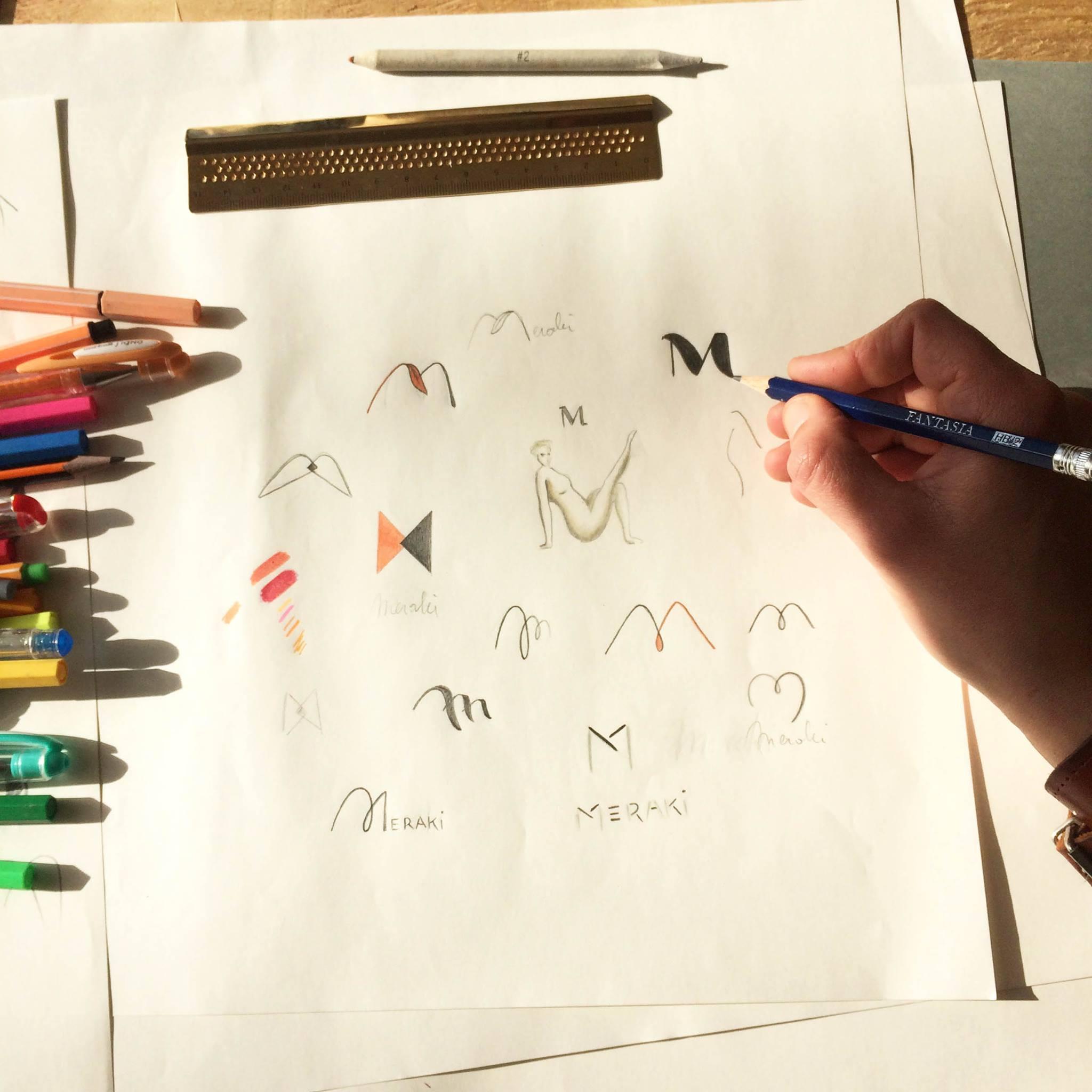 schetsen Meraki logo