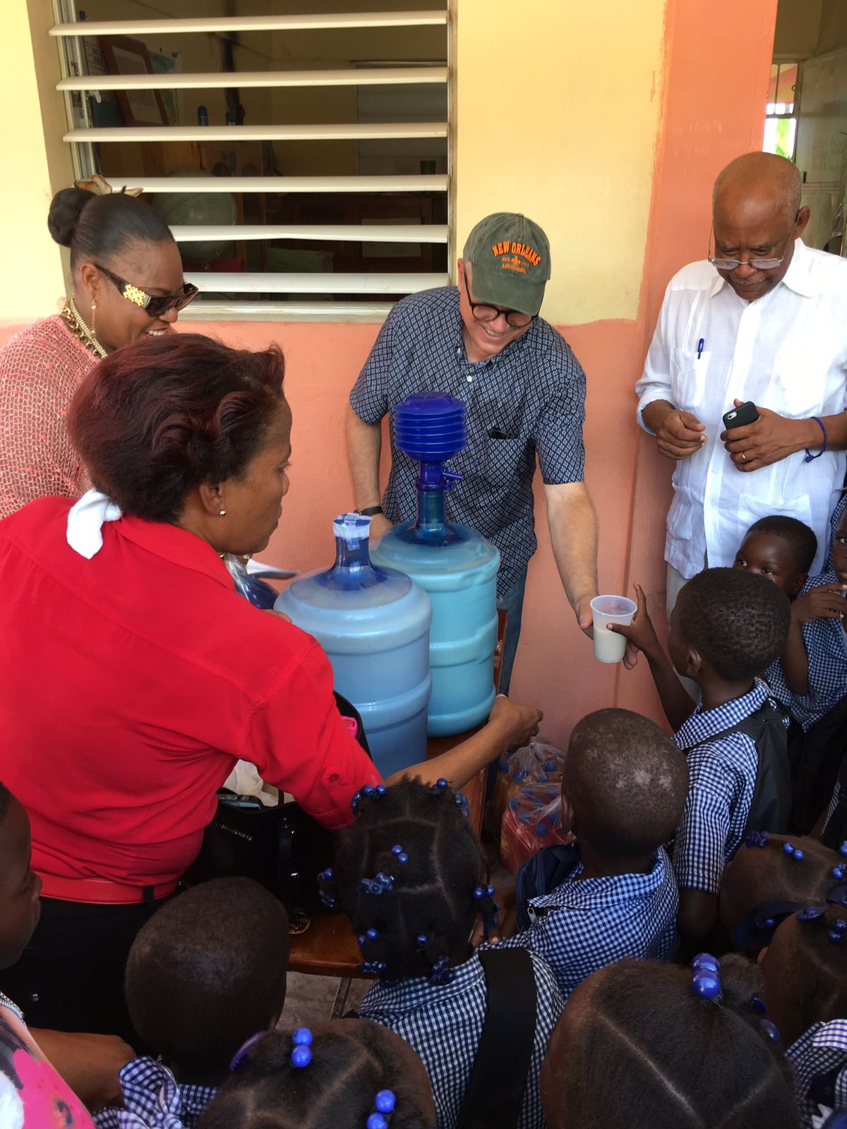 Distributing SoyShake to children in a rural school directly impacted by the hurricane