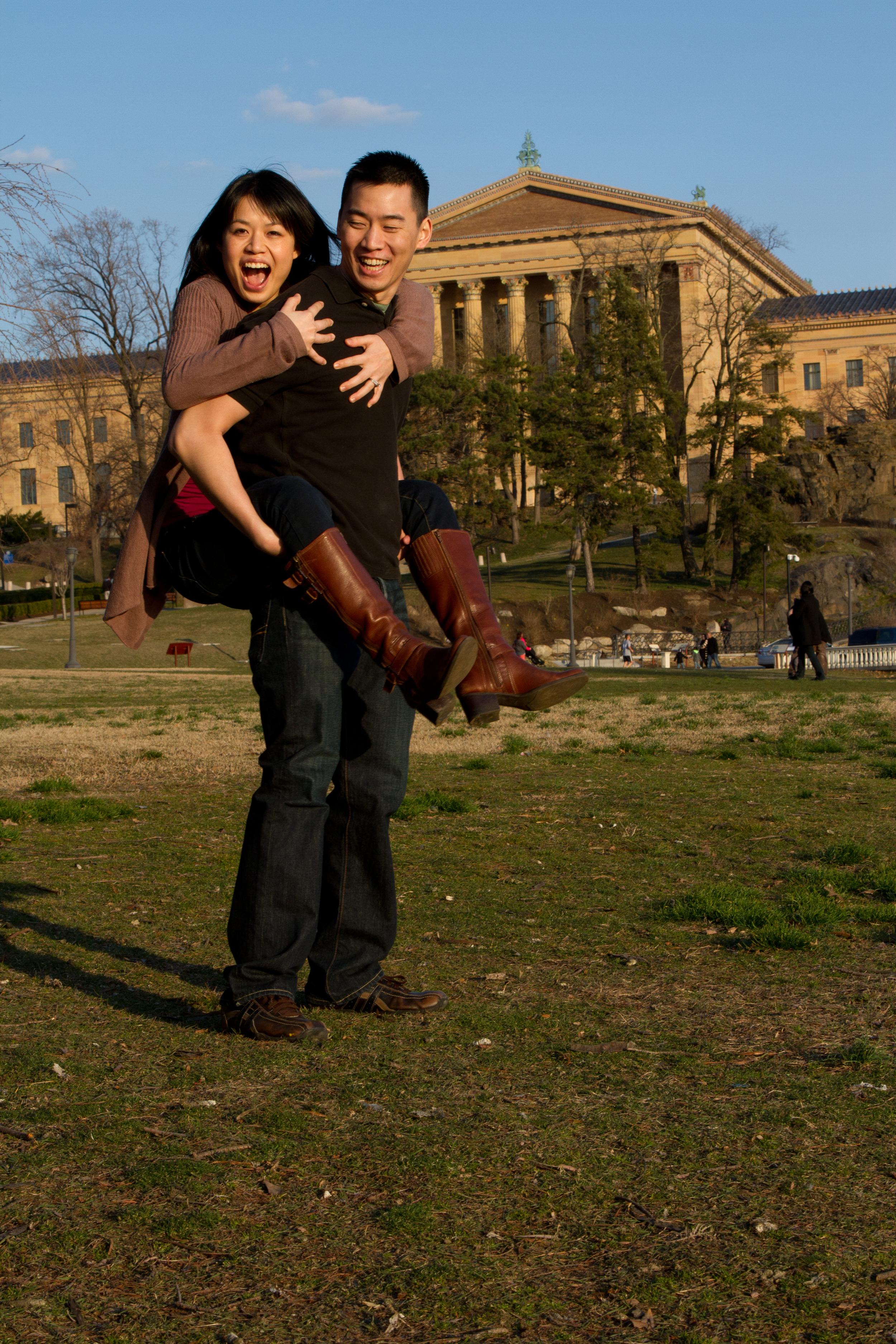 Engagement Photographer Philadelphia Museum of Art Jump on Back Piggy Back Happy She Said Yes