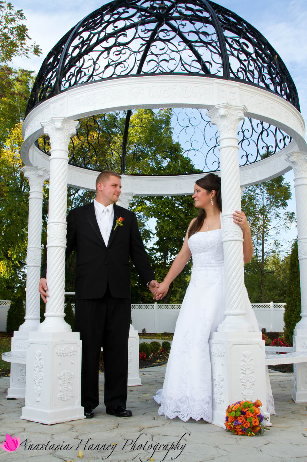 Wedding Photography of Bride and Groom Holding Hands in Gazebo at The Palace in Blackwood New Jersey by Anastasia Hanney Photography AHanneyPhoto