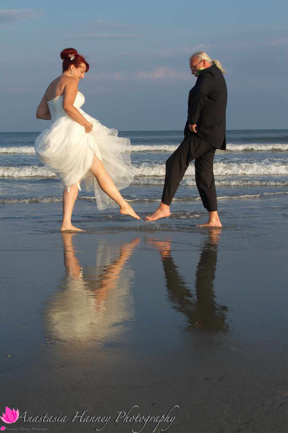 Wedding Photography of Bride and Groom on Beach with Reflection in Ocean City New Jersey by Anastasia Hanney Photography AHanneyPhoto